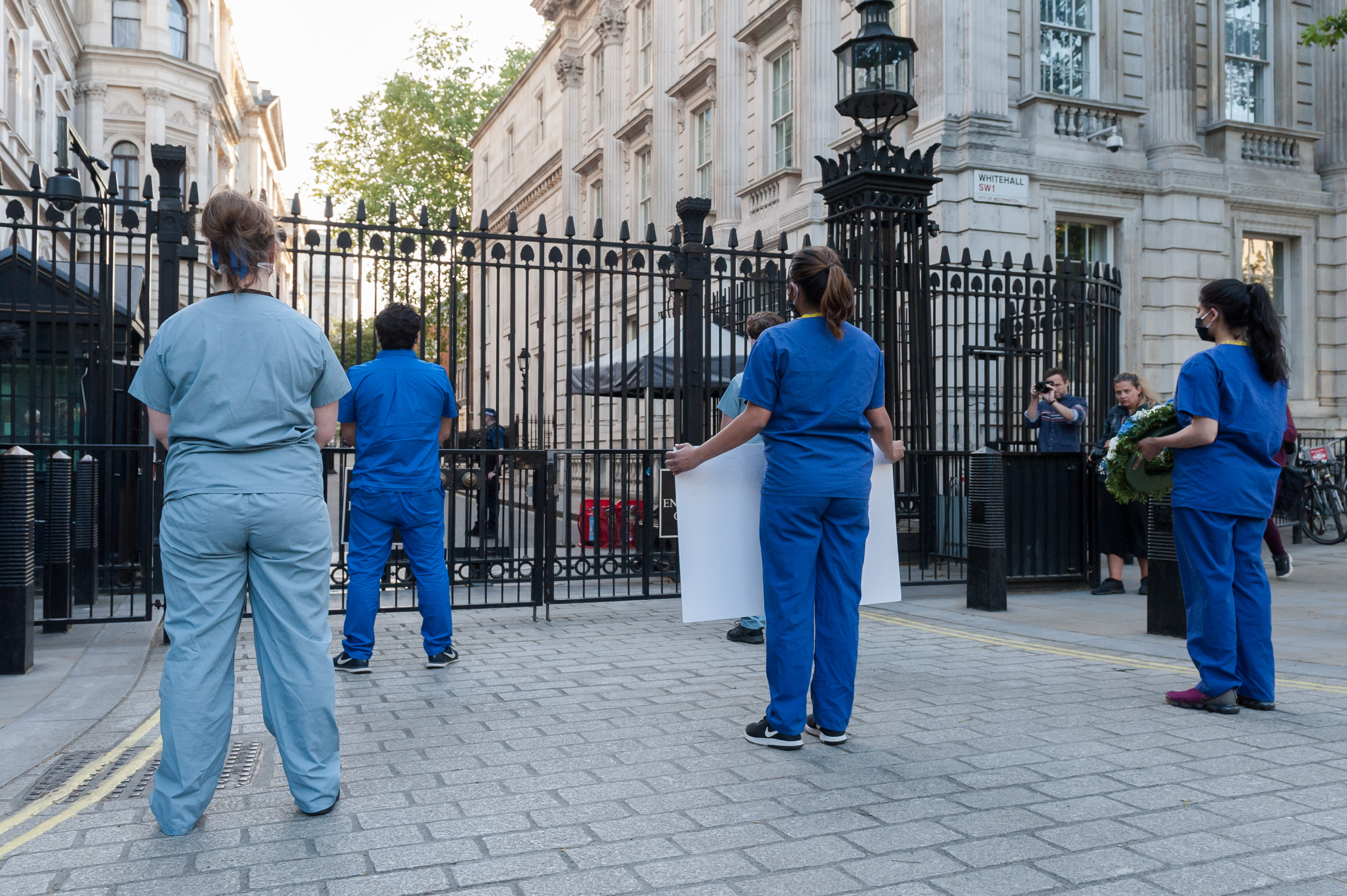LONDON, UNITED KINGDOM - MAY 28, 2020: NHS staff stage a silent protest outside the gates of Downing Street during the weekly 'Clap for our Carers' applause for the NHS and key workers on the front line of the coronavirus (Covid-19) pandemic on 28 May, 2020 in London, England.- PHOTOGRAPH BY Wiktor Szymanowicz / Barcroft Studios / Future Publishing (Photo credit should read Wiktor Szymanowicz/Barcroft Media via Getty Images)