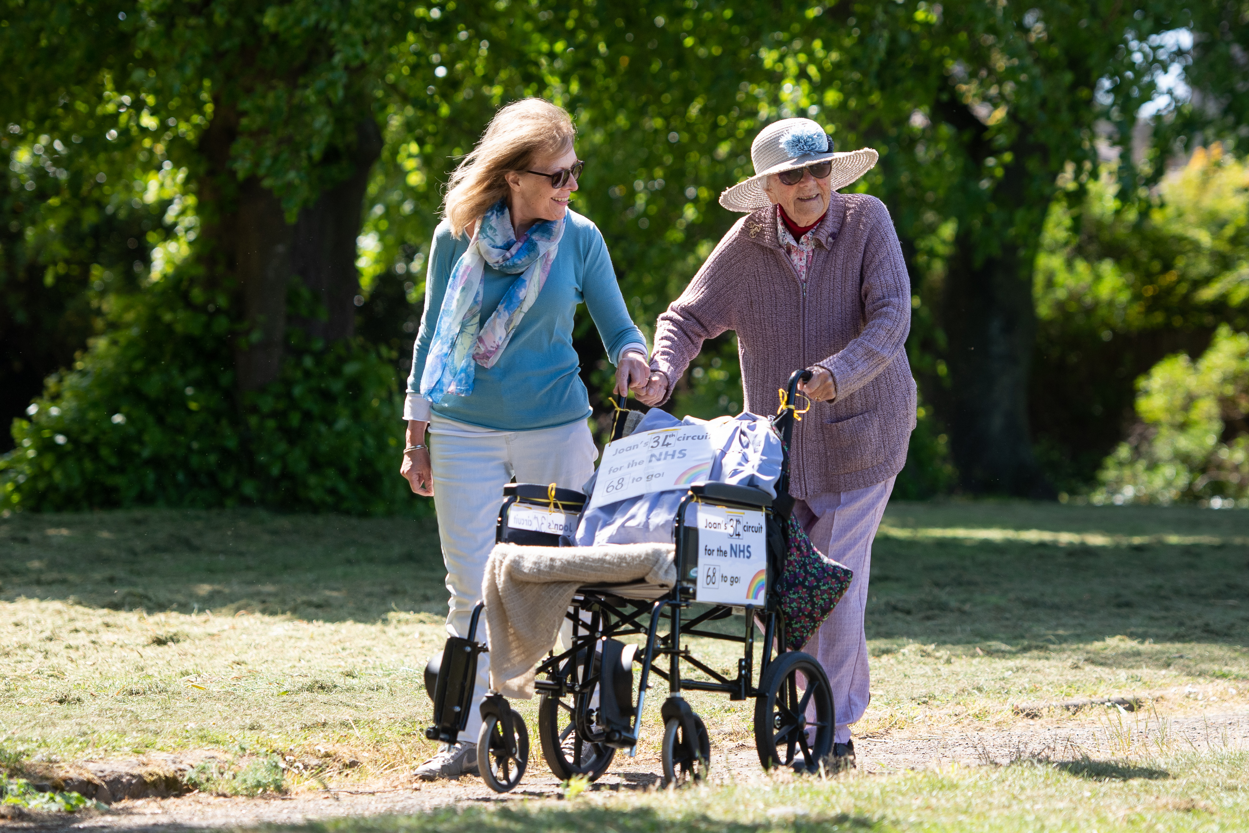 Former nurse Joan Rich, 101, walks through Allenby Park in Felixstowe, Suffolk, to raise money for NHS Charities Together. Mrs Rich, who uses a frame to aid her walking, aims to walk 102 laps of the park before her 102nd birthday on 11 September. (Photo by Joe Giddens/PA Images via Getty Images)