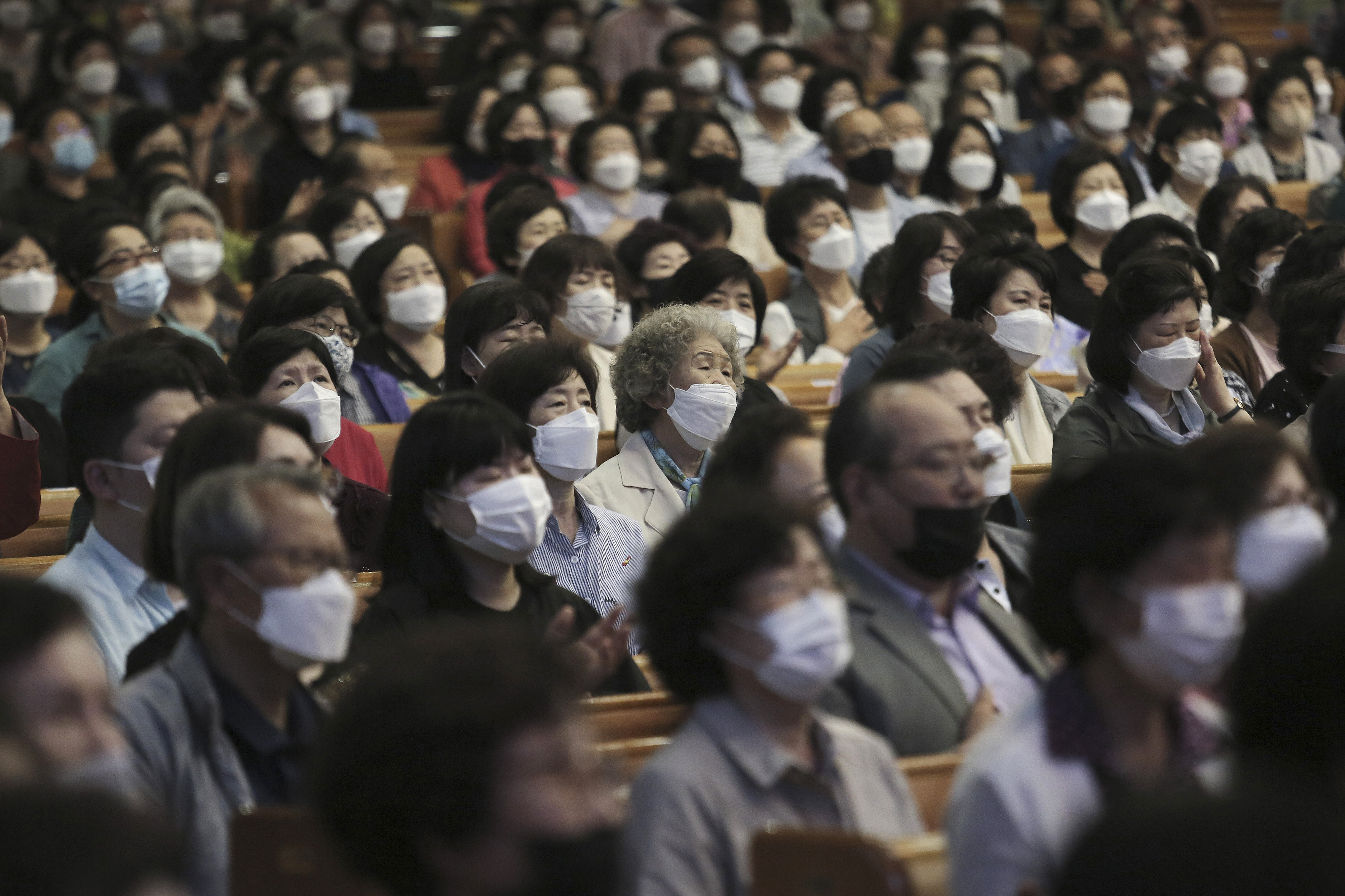 Christians wearing face masks to help protect against the spread of the new coronavirus attend a service at the Yoido Full Gospel Church in Seoul, South Korea, Sunday, May 31, 2020. (AP Photo/Ahn Young-joon)