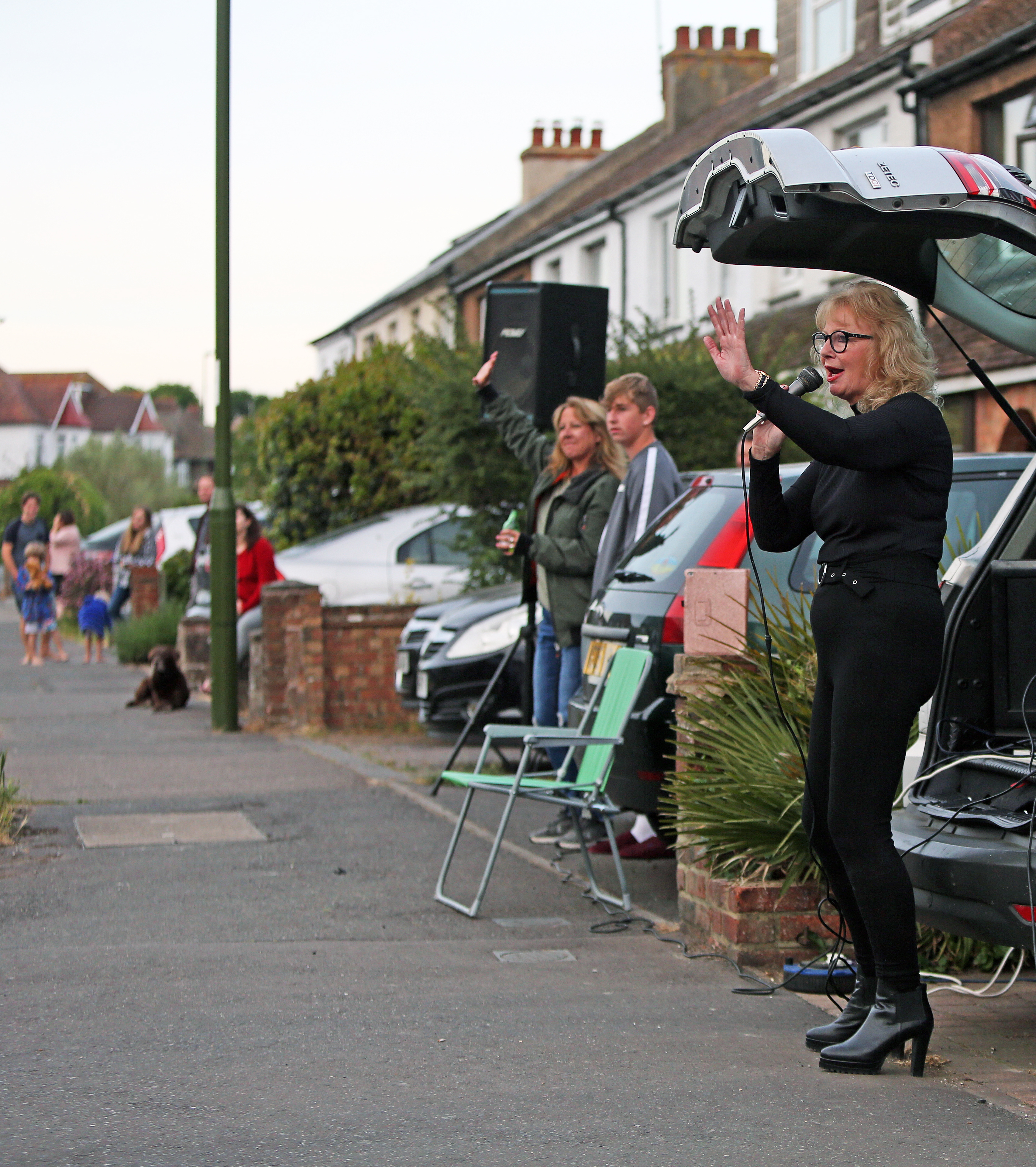 A woman, Tina Jane from Shoreham, sings songs out the back of her car to entertain the people that live on her street after the Clap for Carers, as the UK continues to ease out of lockdown to curb the spread of coronavirus.