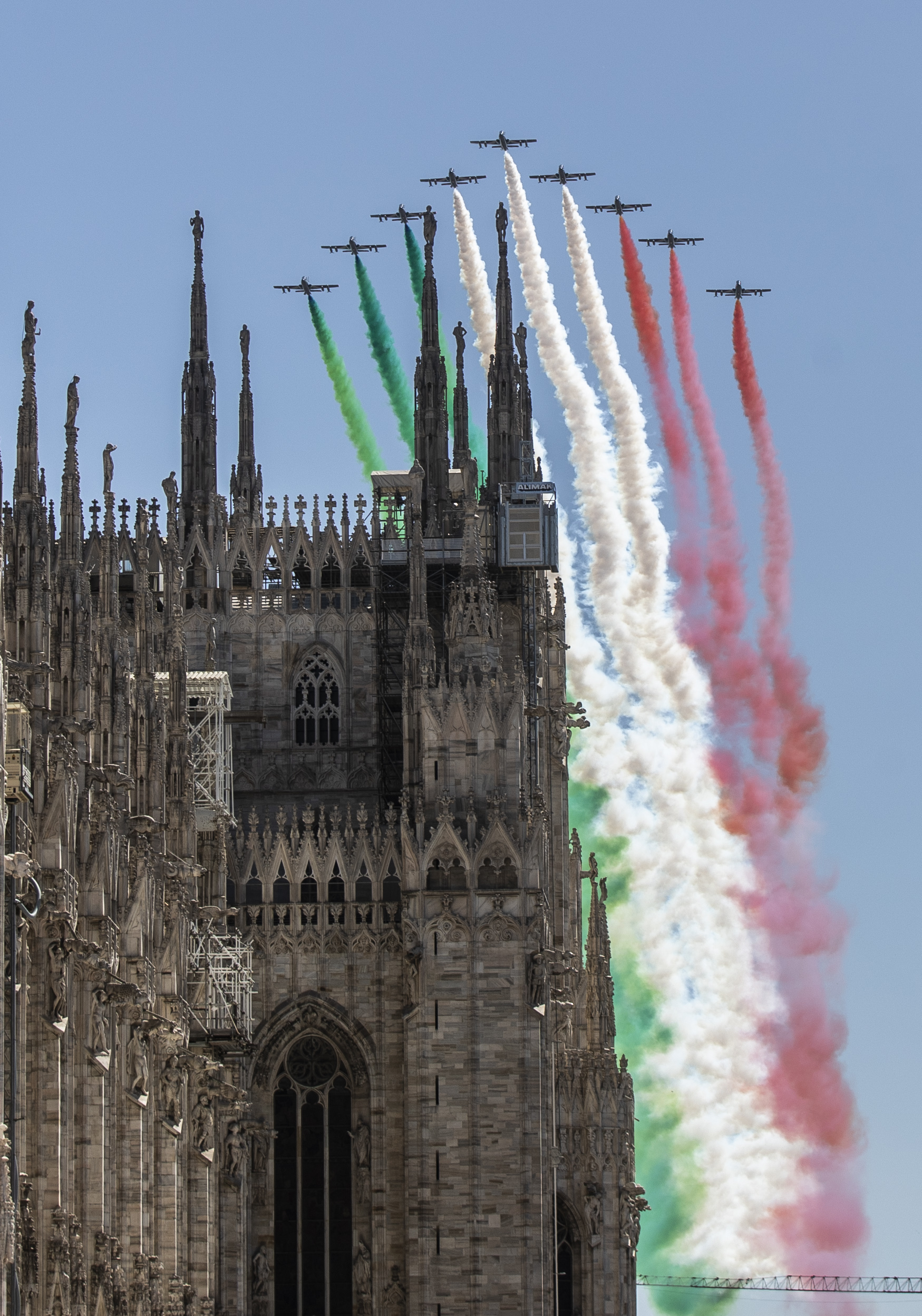 The Frecce Tricolori aerobatic squad of the Italian Air Force flies over Milan's Duomo cathedral, northern Italy, Monday, May 25, 2020 on the occasion of the 74th anniversary of the founding of the Italian Republic on June 2, 1946. This year the acrobatic squad will fly over several Italian cities to bring a message of unity and solidarity during the coronavirus pandemic.(AP Photo/Luca Bruno)