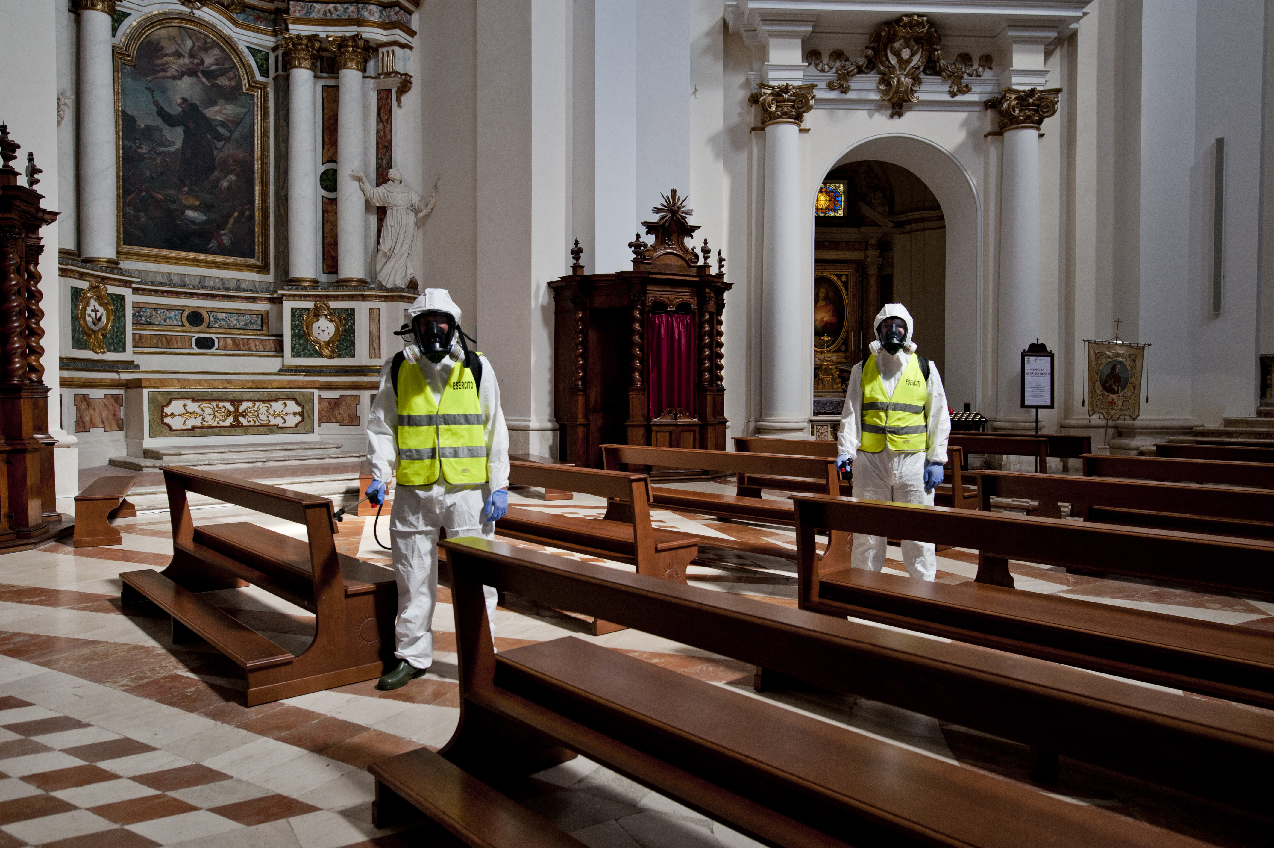 Potrait of Disinfectors of the 9th Alpine Regiment, in L'Aquila, Italy, on May 20, 2027, during sanitize in an Church.  Disinfectors of the 9th Alpine Regiment sanitize the Cathedral of St. Bernardino from Siena. The 9th Alpine Regiment intervenes in the sanitization of one of the symbol places of worship of the city of L'Aquila. (Photo by Andrea Mancini/NurPhoto via Getty Images)