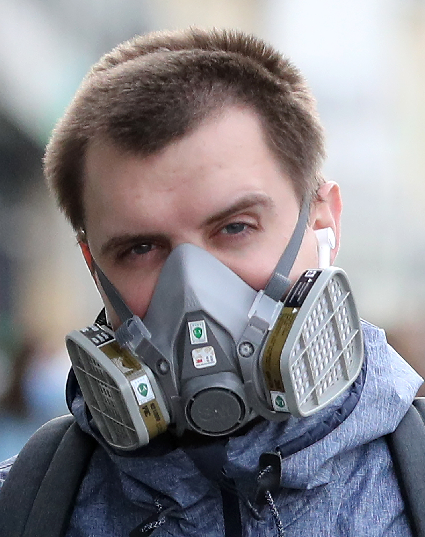 MOSCOW, RUSSIA - MAY 28, 2020: A man wears a respirator in a street. The self-isolation regime is extended in Moscow through June 14 in order to prevent the spread of the novel coronavirus infection. Mikhail Tereshchenko/TASS (Photo by Mikhail Tereshchenko\TASS via Getty Images)