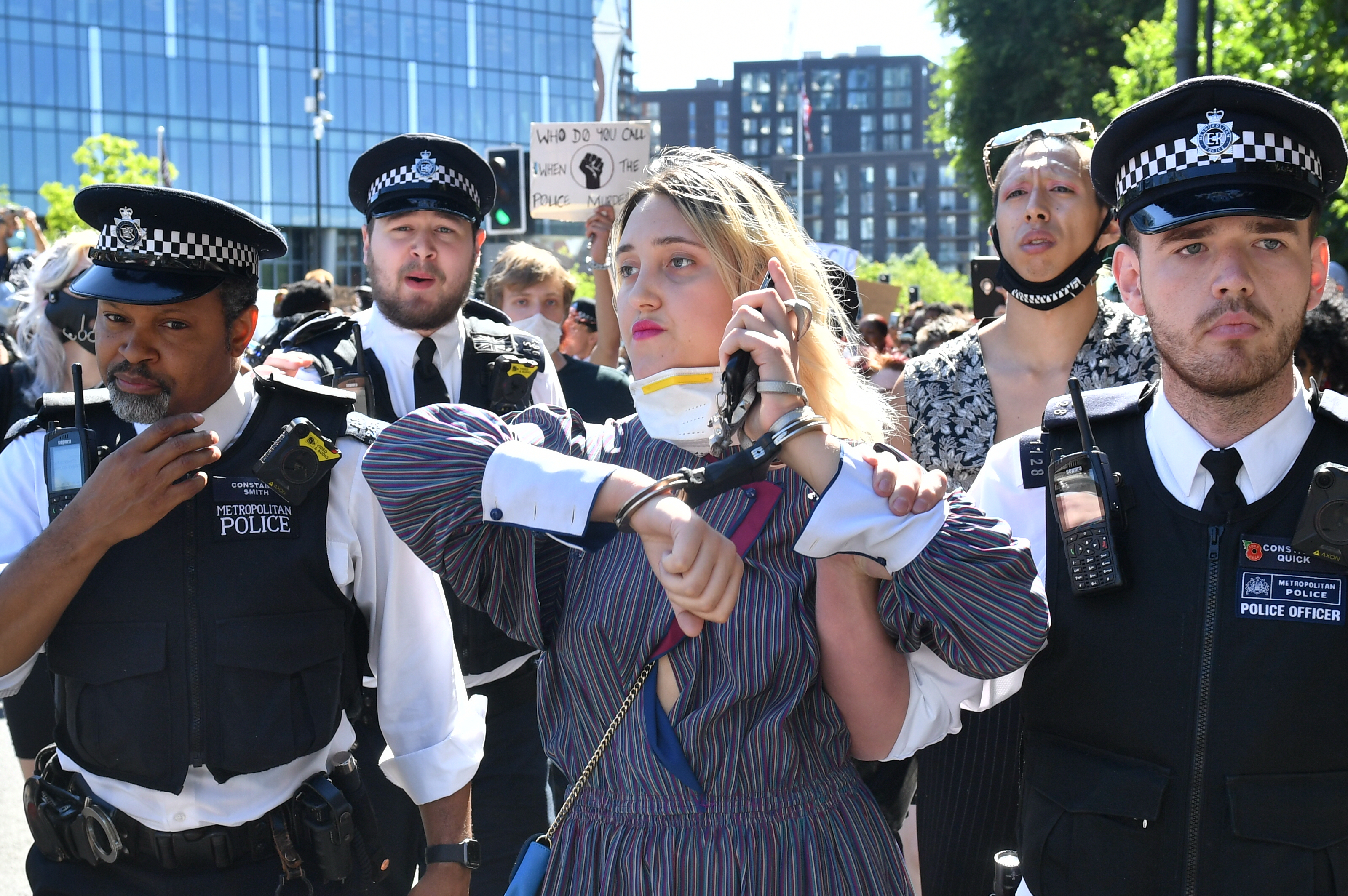 A woman is led away by police during a Black Lives Matter protest outside the US Embassy in London. The protest follows the death of George Floyd in Minneapolis, US, this week which has seen a police officer charged with third-degree murder. (Photo by Dominic Lipinski/PA Images via Getty Images)