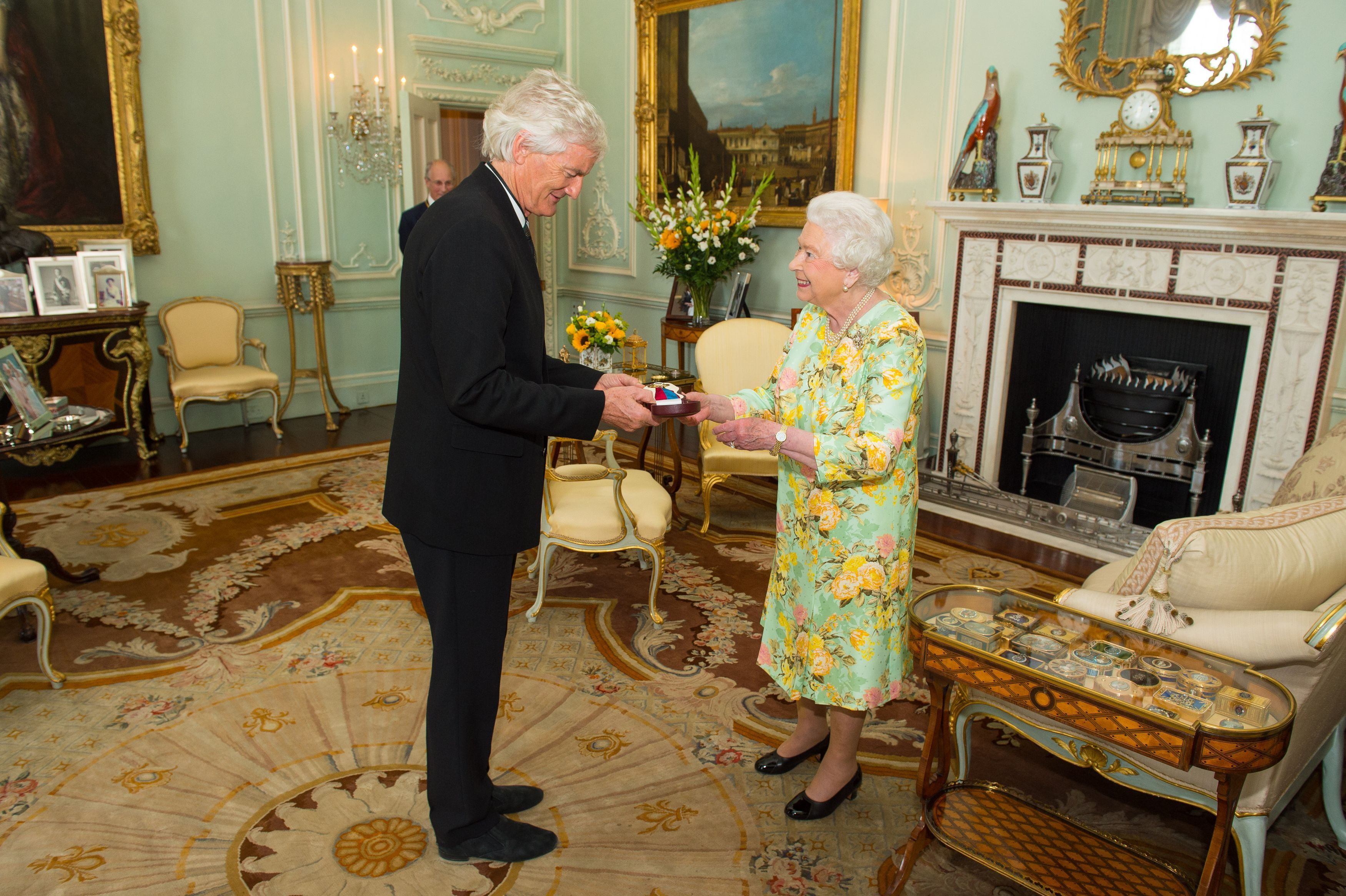 Queen Elizabeth II presents Sir James Dyson with the insignia with the insignia of members of the Order of Merit, during a private audience at Buckingham Palace, London.