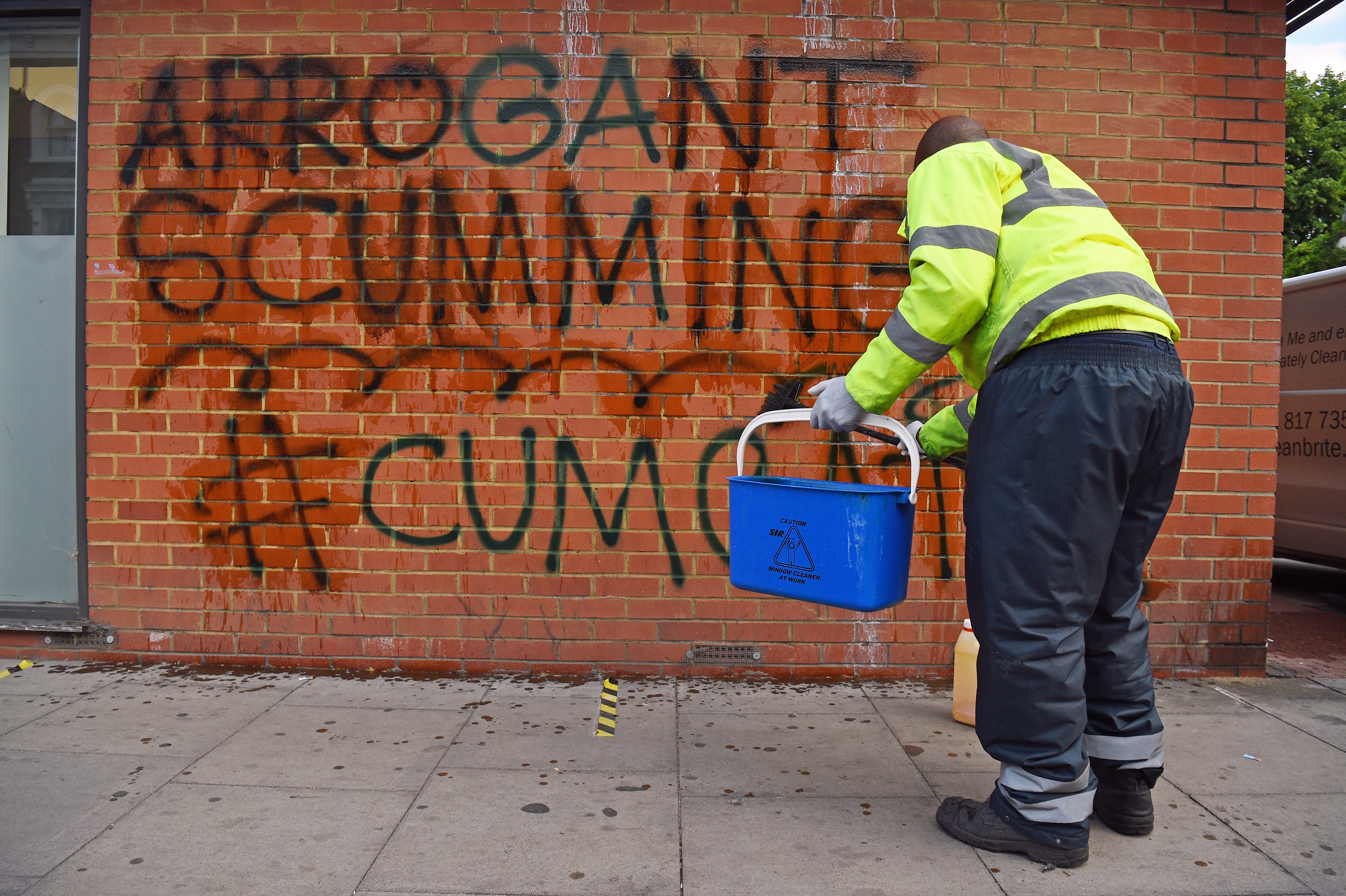 A workman removes graffiti from a wall near the north London home of the Prime Minister's top aide Dominic Cummings as the row over his Durham trip during the coronavirus lockdown continues. (Photo by Kirsty O'Connor/PA Images via Getty Images)