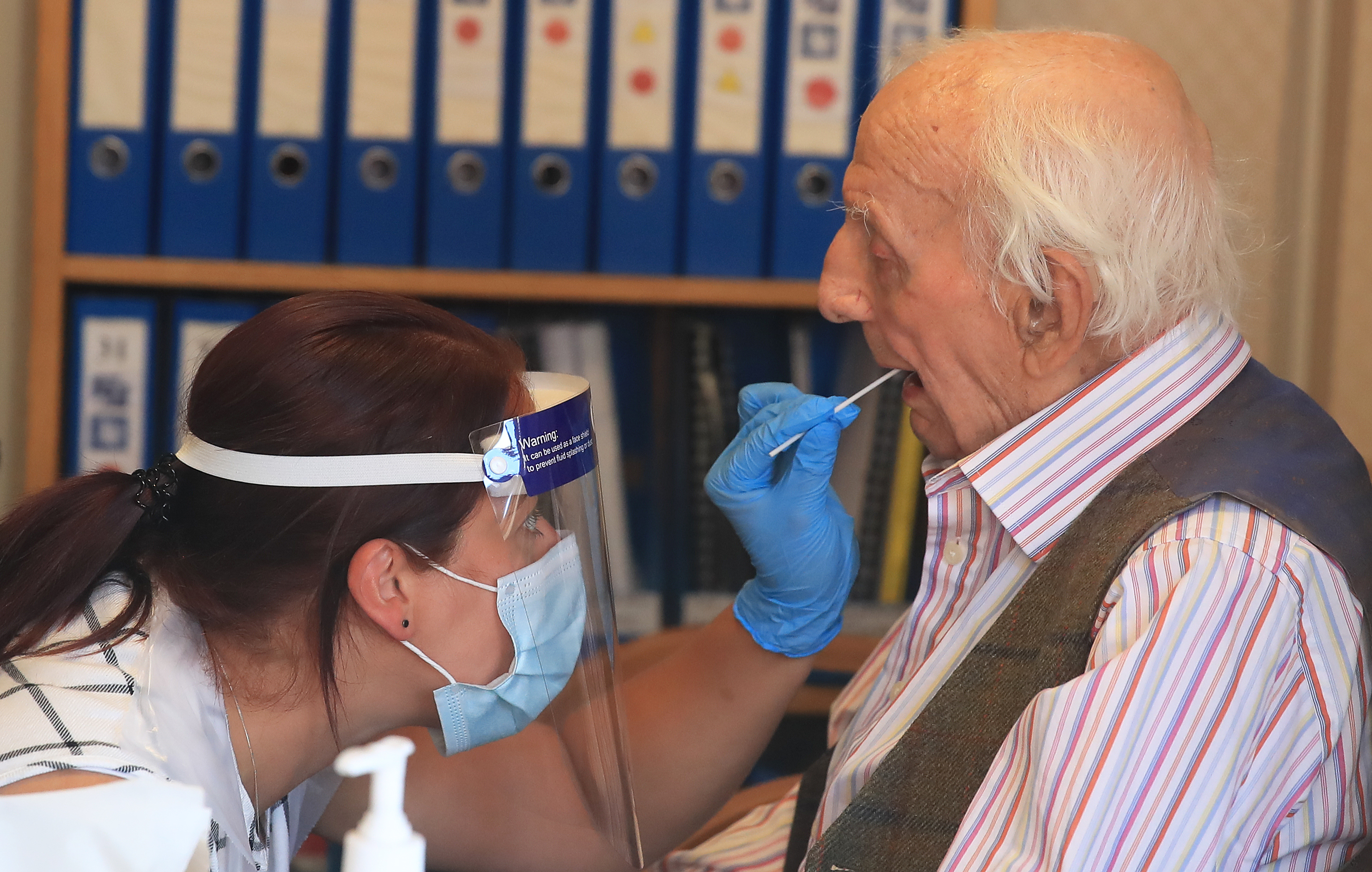 Assistant manager Claire Welford administers a coronavirus swab test on resident Harry Hall, 94, at the Eothen Homes care home in Whitley Bay, Tyneside, where all staff and residents are being tested for coronavirus. (Photo by Owen Humphreys/PA Images via Getty Images)