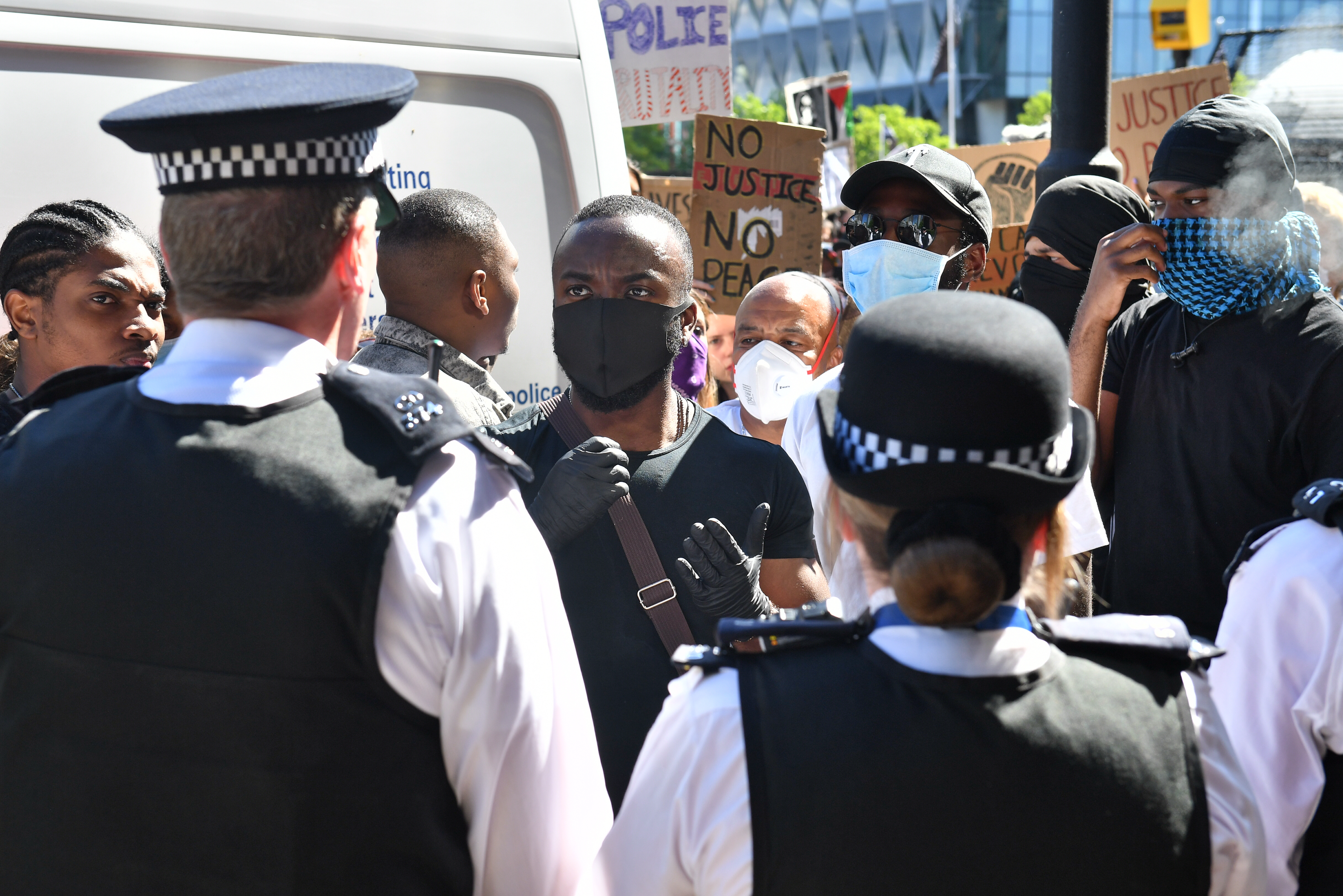 People take part in a Black Lives Matter protest outside the US Embassy in London. The protest follows the death of George Floyd in Minneapolis, US, this week which has seen a police officer charged with third-degree murder. (Photo by Dominic Lipinski/PA Images via Getty Images)