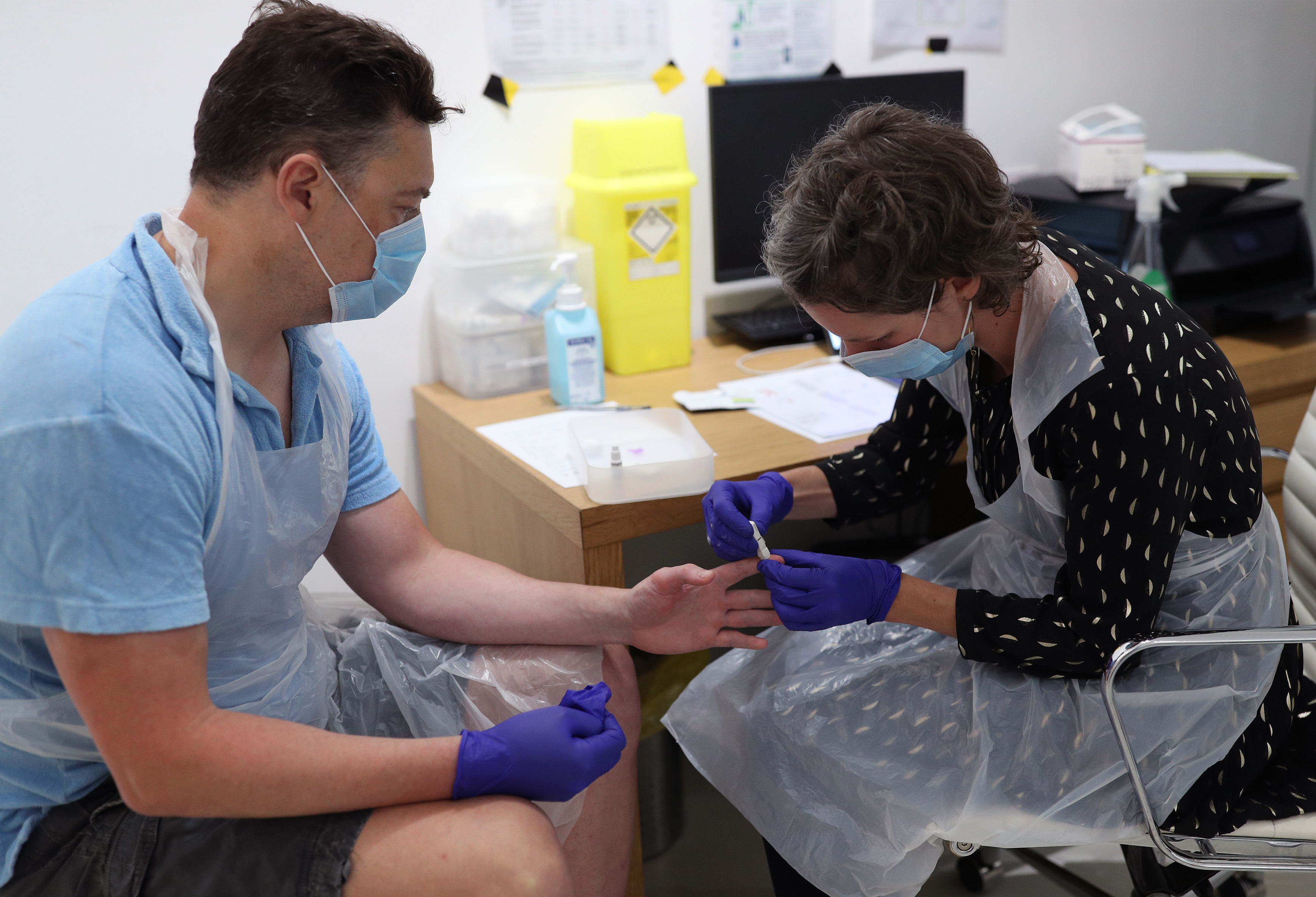 Katy Peters, of the London Vaccination Clinic, performs a German-made Nadal rapid antibody fingertip test for the detection of COVID-19 on client David Barton, a Capital markets lawyer aged 49, in Notting Hill, London, as the UK continues in lockdown to help curb the spread of the coronavirus.