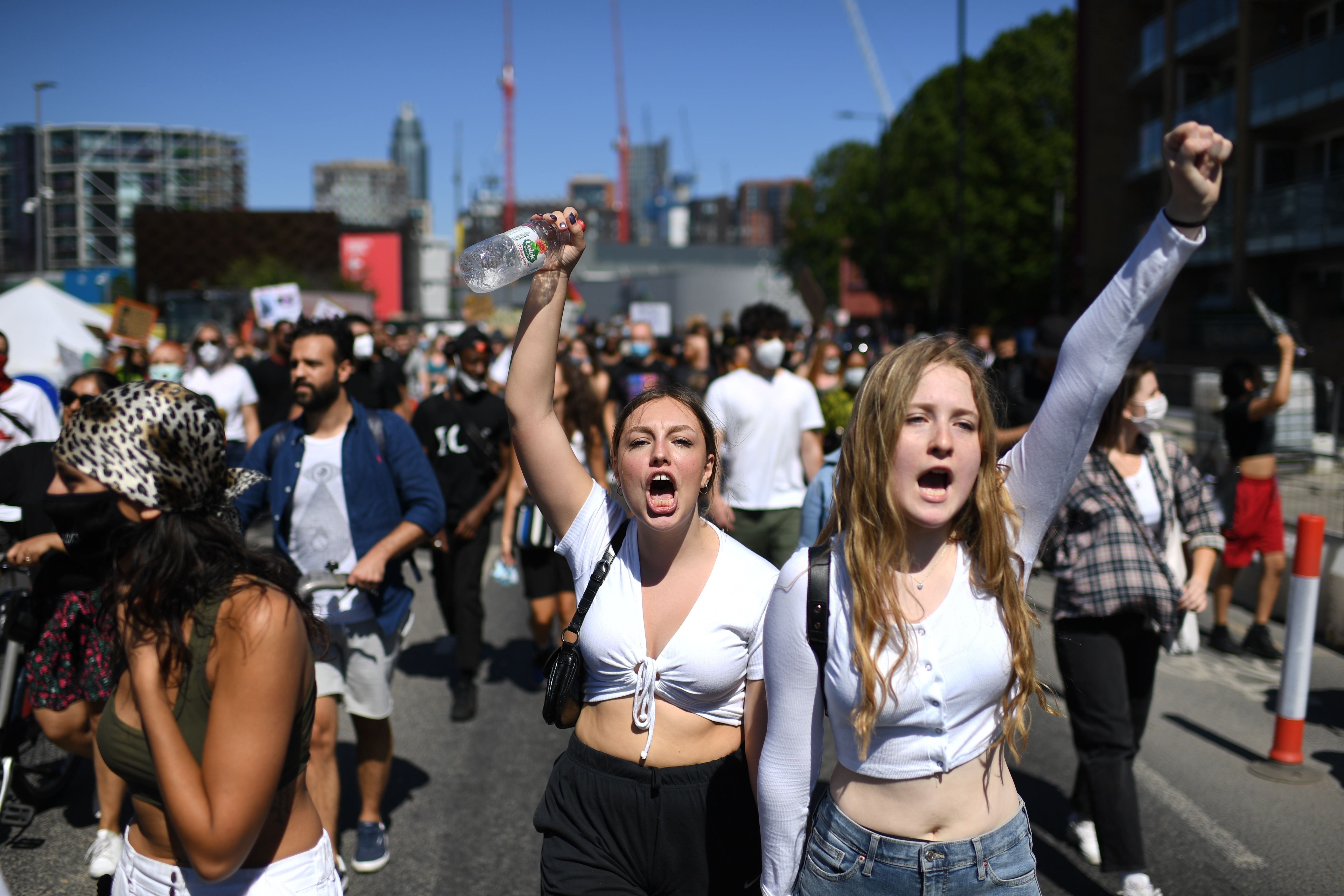 Demonstrators shout slogans as they march in the road outside the US Embassy in London on May 31, 2020 to protest the death of George Floyd, an unarmed black man who died after a police officer knelt on his neck for nearly nine minutes during an arrest in Minneapolis, USA. - Hundreds gathered in central London and marched to teh US Embassy to protest the death of an unarmed black man in Minneapolis while in police custody that has sparked days of unrest in the US city and beyond. (Photo by DANIEL LEAL-OLIVAS / AFP) / The erroneous mention[s] appearing in the metadata of this photo by DANIEL LEAL-OLIVAS has been modified in AFP systems in the following manner: [London] instead of [Brighton]. Please immediately remove the erroneous mention[s] from all your online services and delete it (them) from your servers. If you have been authorized by AFP to distribute it (them) to third parties, please ensure that the same actions are carried out by them. Failure to promptly comply with these instructions will entail liability on your part for any continued or post notification usage. Therefore we thank you very much for all your attention and prompt action. We are sorry for the inconvenience this notification may cause and remain at your disposal for any further information you may require. (Photo by DANIEL LEAL-OLIVAS/AFP via Getty Images)