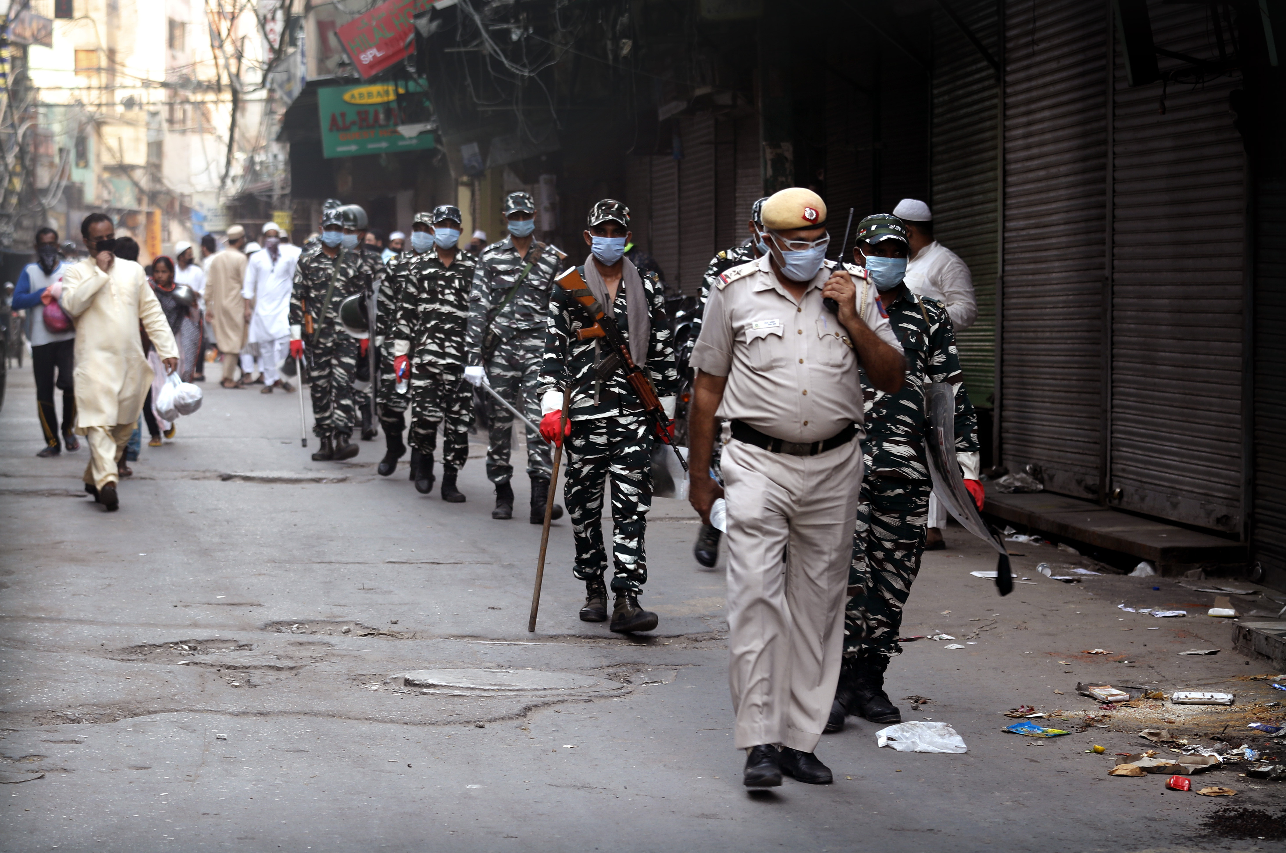Indian policemen patrol during Eid al-Fitr near the Jama Mosque at the old quarters of New Delhi, India, Monday, May 25, 2020. The holiday of Eid al-Fitr, the end of the fasting month of Ramadan, a usually joyous three-day celebration has been significantly toned down as coronavirus cases soar. (AP Photo/Manish Swarup)