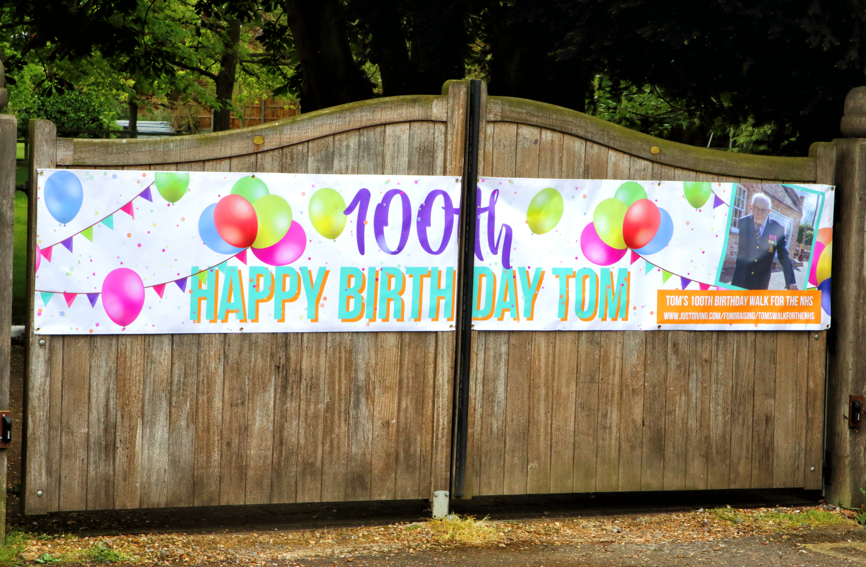 Large Banner on the gates of Captain Tom's house, The Old Rectory during the covid-19 pandemic. Messages of Congratulations all around the village of Marston Moretaine, Bedfordshire, UK to celebrate the 100th Birthday of Captain Tom Moore, who lives with his family in the village, set out at the beginning of April to walk 100 laps of his garden to hopefully raise �1000 for the NHS (National Health Services) during the Covid-19 Pandemic. Press coverage of his walk went worldwide and the phenomenon finally raised over �32 million and cementing himself as a National - and International - Hero. (Photo by Keith Mayhew / SOPA Images/Sipa USA)