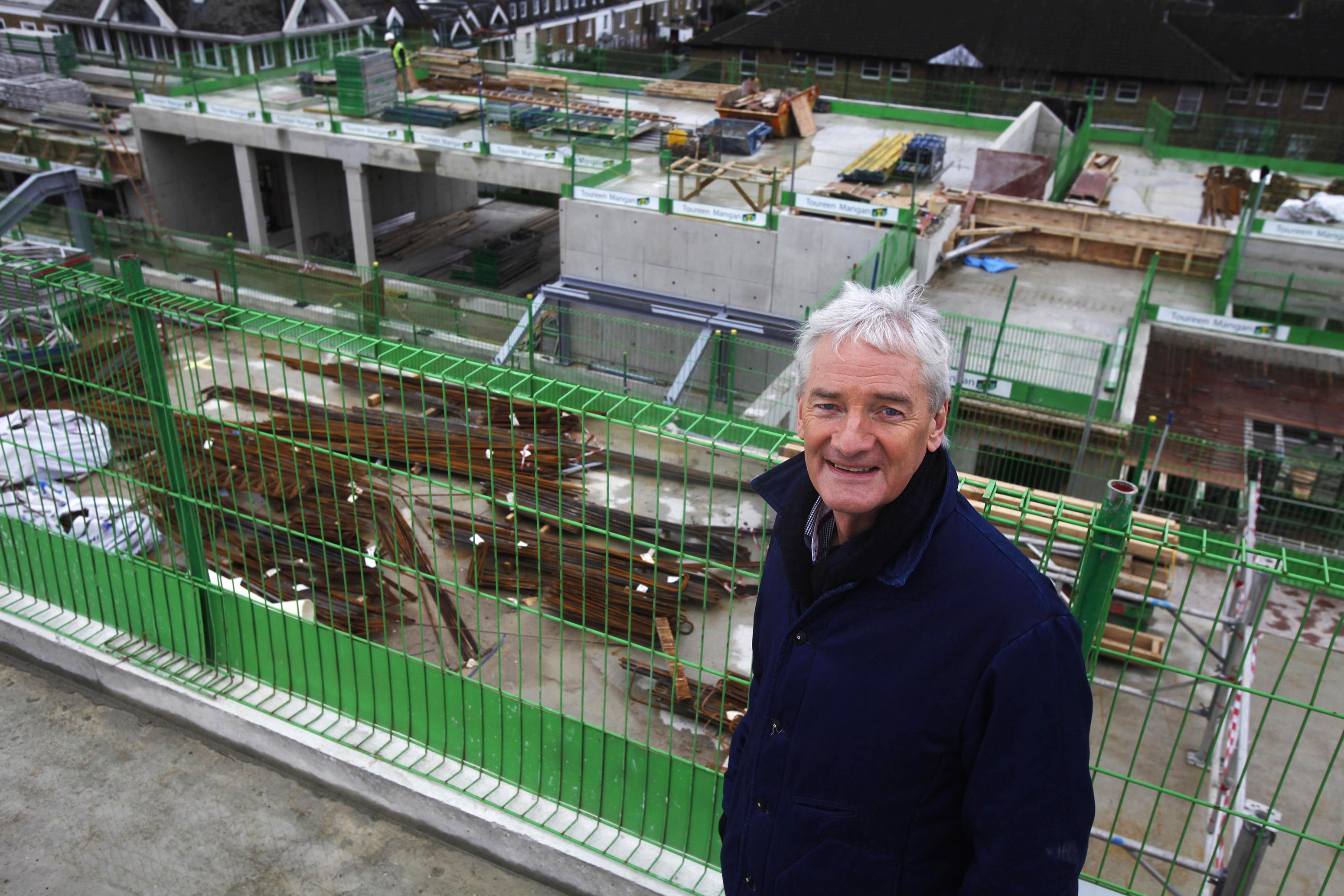 James Dyson climbs to the top of the Royal College of Arts new building in Battersea for the topping out ceremony.