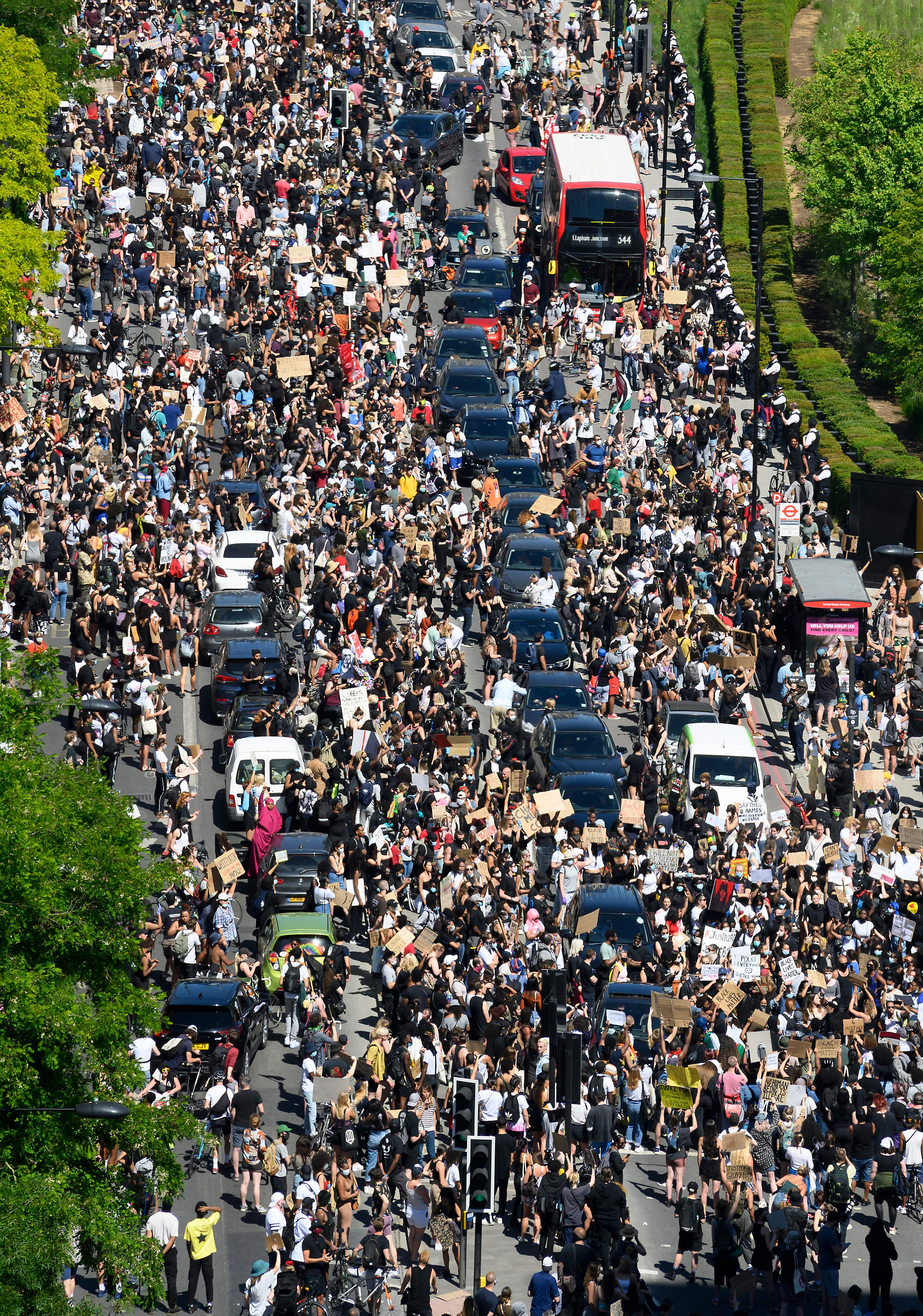 Demonstrators block the road as they gather outside the US Embassy in London on May 31, 2020 to protest the death of George Floyd, an unarmed black man who died after a police officer knelt on his neck for nearly nine minutes during an arrest in Minneapolis, USA. - Hundreds gathered in central London and marched to teh US Embassy to protest the death of an unarmed black man in Minneapolis while in police custody that has sparked days of unrest in the US city and beyond. (Photo by JUSTIN TALLIS / AFP) / The erroneous mention[s] appearing in the metadata of this photo by JUSTIN TALLIS has been modified in AFP systems in the following manner: [London] instead of [Brighton]. Please immediately remove the erroneous mention[s] from all your online services and delete it (them) from your servers. If you have been authorized by AFP to distribute it (them) to third parties, please ensure that the same actions are carried out by them. Failure to promptly comply with these instructions will entail liability on your part for any continued or post notification usage. Therefore we thank you very much for all your attention and prompt action. We are sorry for the inconvenience this notification may cause and remain at your disposal for any further information you may require. (Photo by JUSTIN TALLIS/AFP via Getty Images)