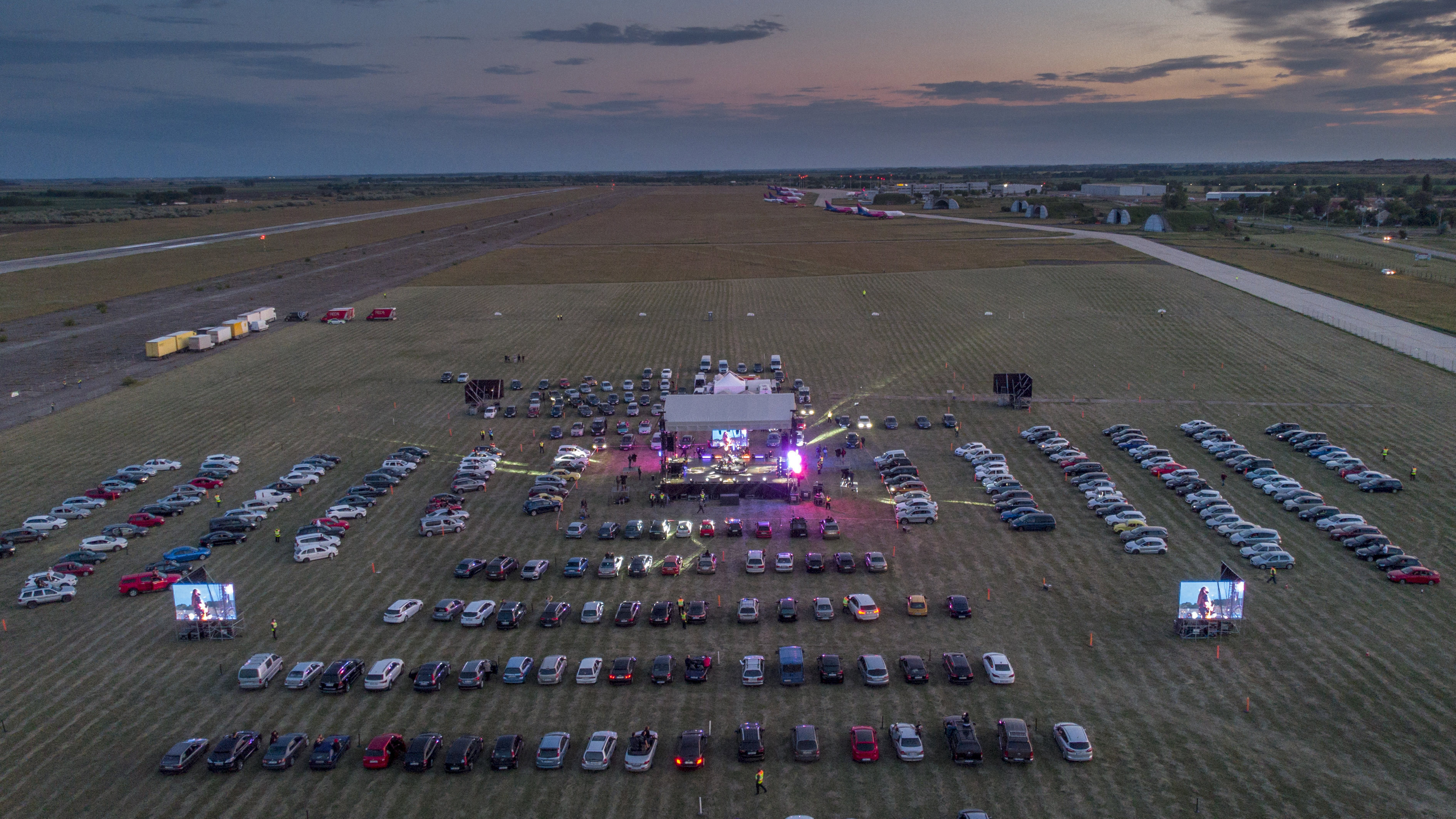 Fans attend the drive-in concert of the Hungarian rock band Tankcsapda at the Debrecen International Airport in Debrecen, Hungary, Friday, May 29, 2020, when concert halls are still closed in Hungary due to the pandemic of the novel coronavirus COVID-19. (Zsolt Czegledi/MTI via AP)