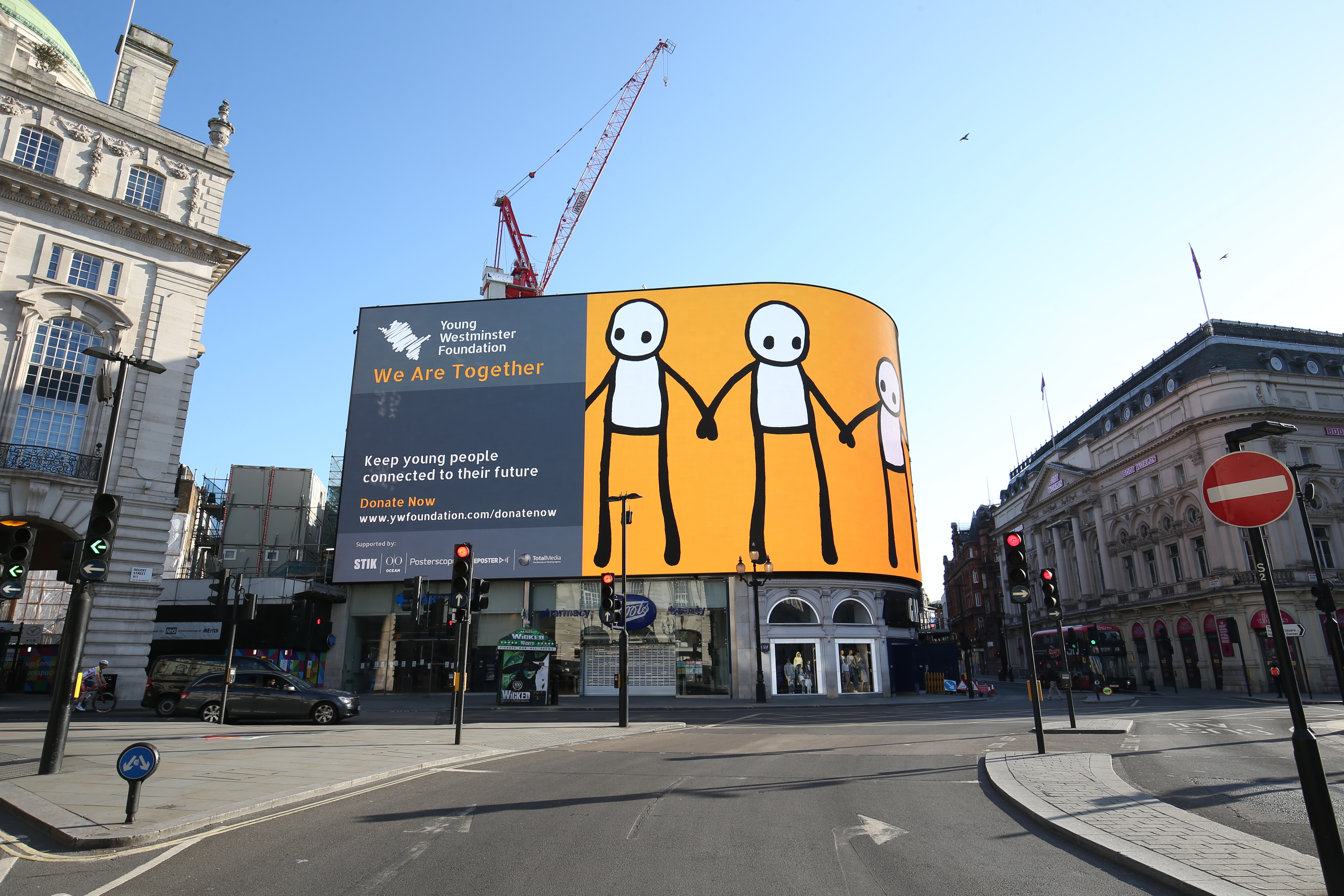 The Young Westminster Foundation (YWF), a charity that supports young people in the Westminster Borough, unveil their new and original digital artwork by the graffiti artist STIK on the Piccadilly Lights screen, at Piccadilly Circus, central London. (Photo by Jonathan Brady/PA Images via Getty Images)
