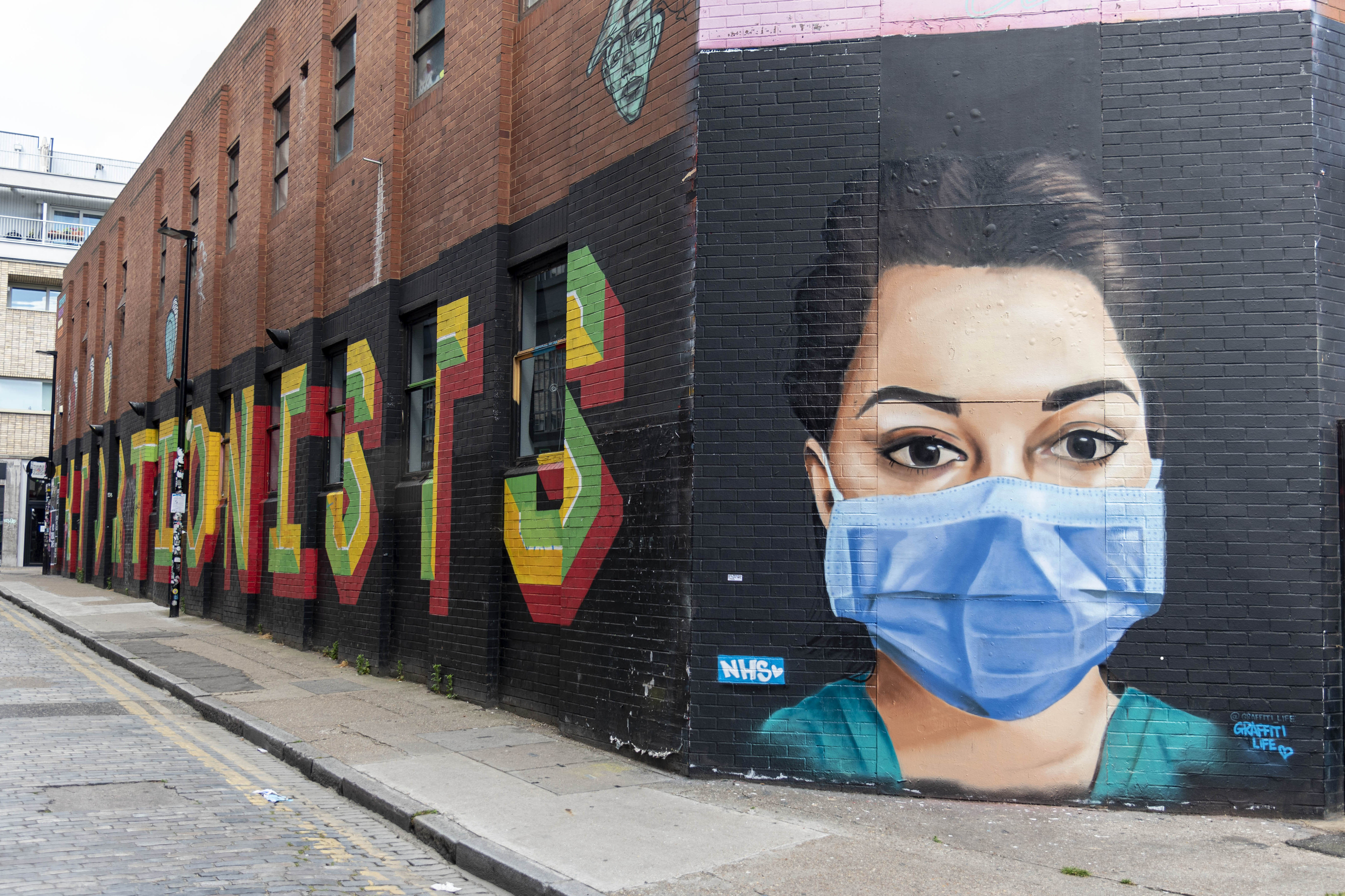 LONDON, UNITED KINGDOM - 2020/05/24: A view of a coronavirus awareness mural and a tribute to NHS workers drawn on a wall during the coronavirus crisis. (Photo by Dave Rushen/SOPA Images/LightRocket via Getty Images)