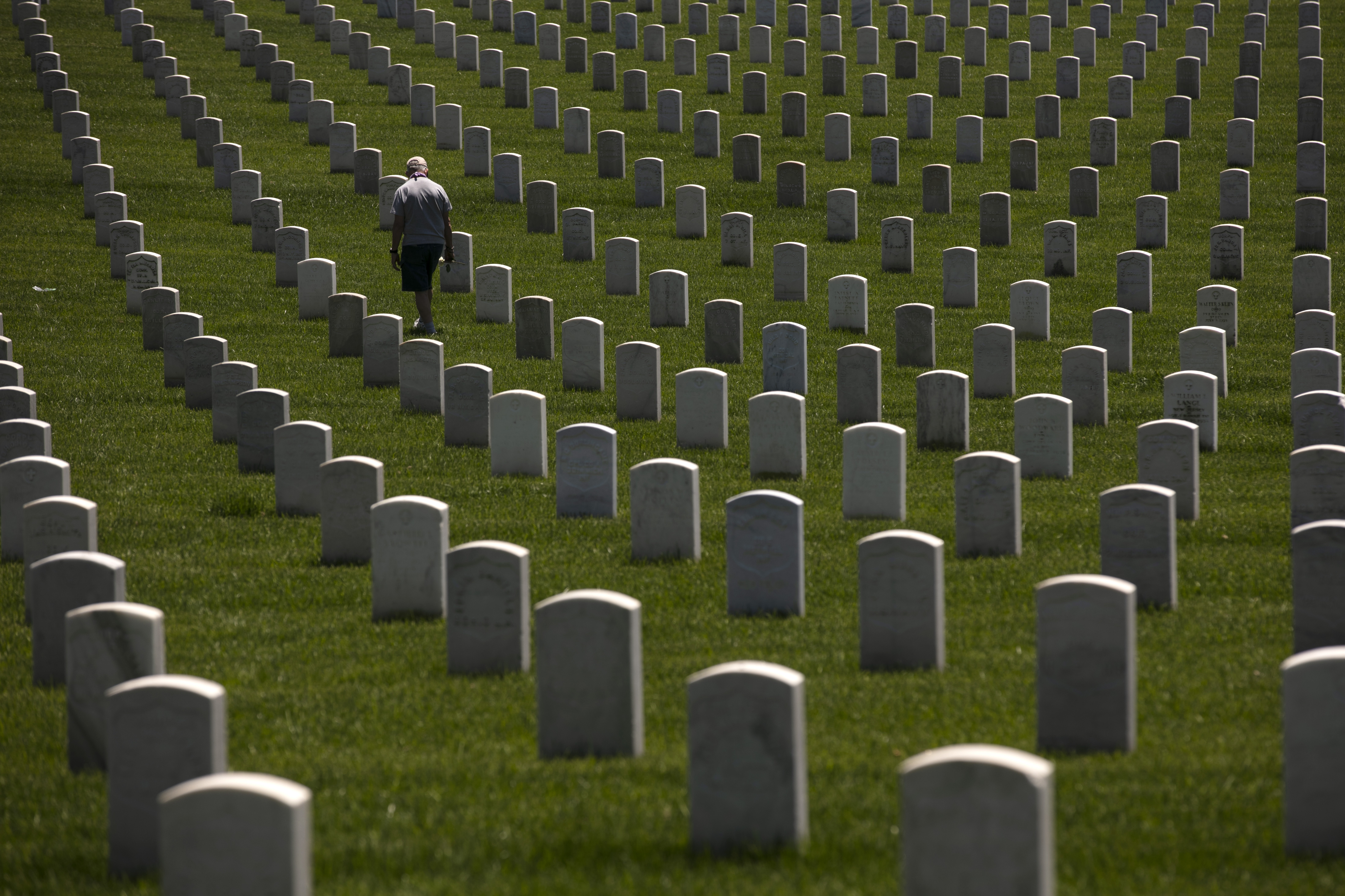John Bickler visits the Los Angeles National Cemetery in Los Angeles, Monday, May 25, 2020. The annual Memorial Day commemoration was held without the public in attendance due to the coronavirus outbreak. (AP Photo/Jae C. Hong)