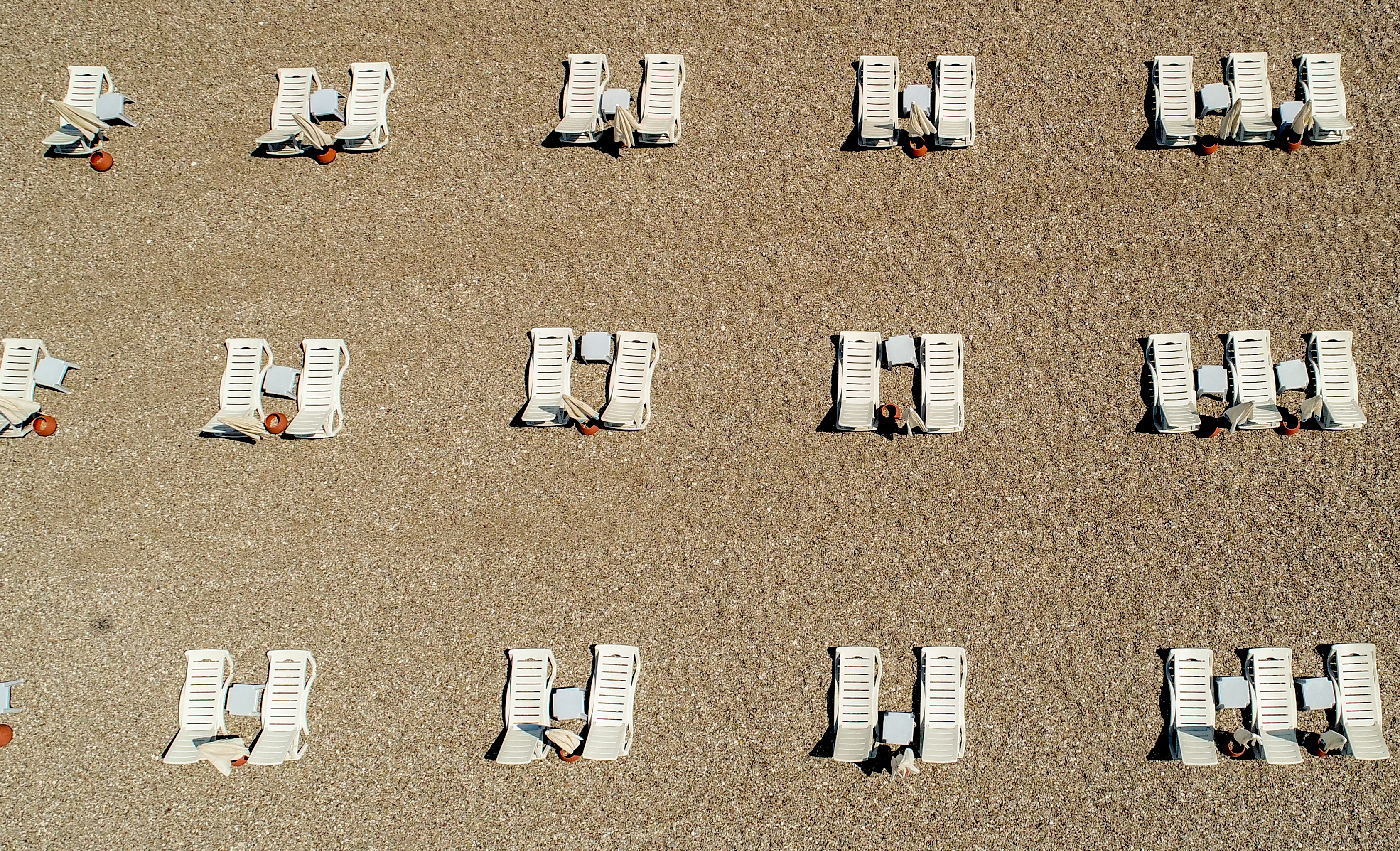 ANTALYA, TURKEY - MAY 28: An aerial view of sunbeds placed to comply the rules of social distance near Konyaalti Coastline within the coronavirus (Covid-19) pandemic measures in Antalya, Turkey on May 28, 2020. (Photo by Mustafa Ciftci/Anadolu Agency via Getty Images)