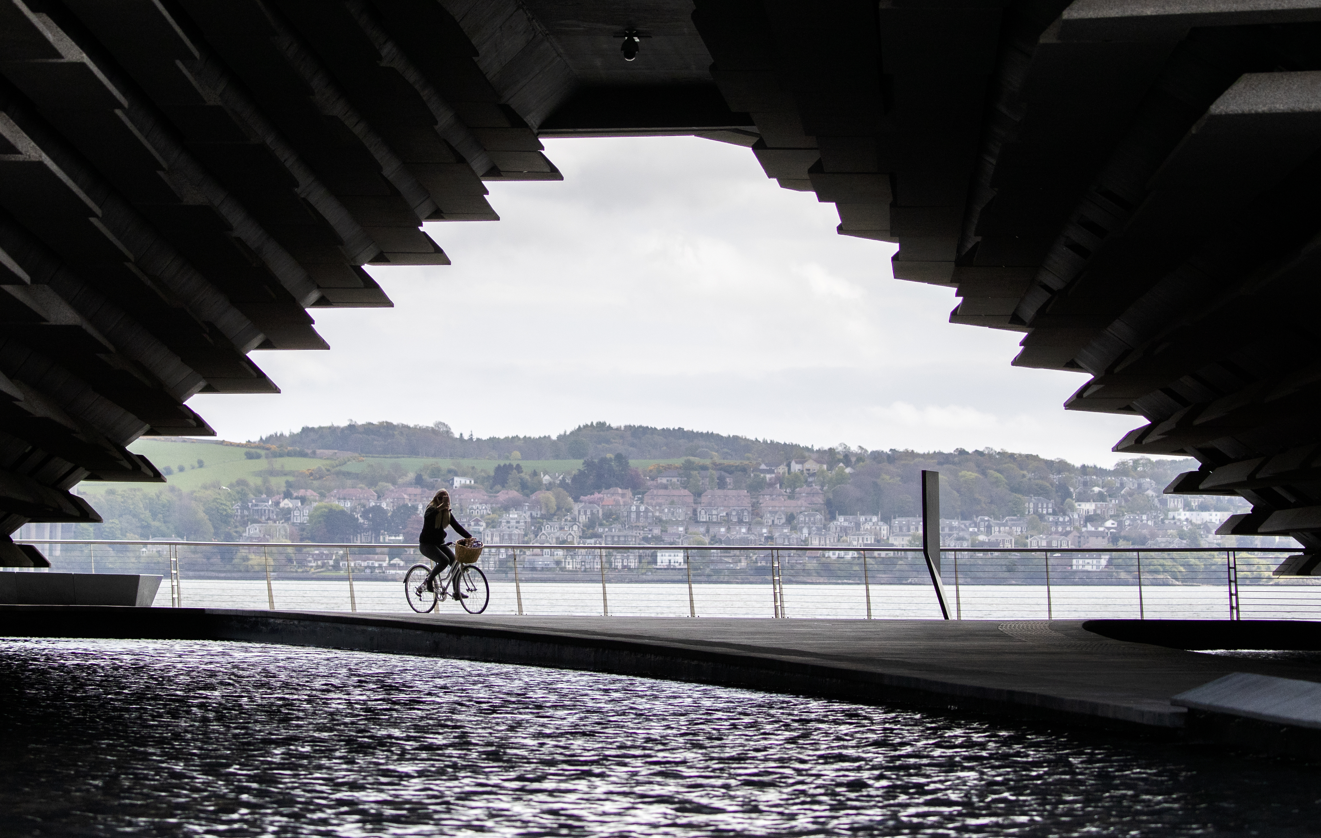A cyclist passes the closed V&A Museum in Dundee as the UK continues in lockdown to help curb the spread of the coronavirus.