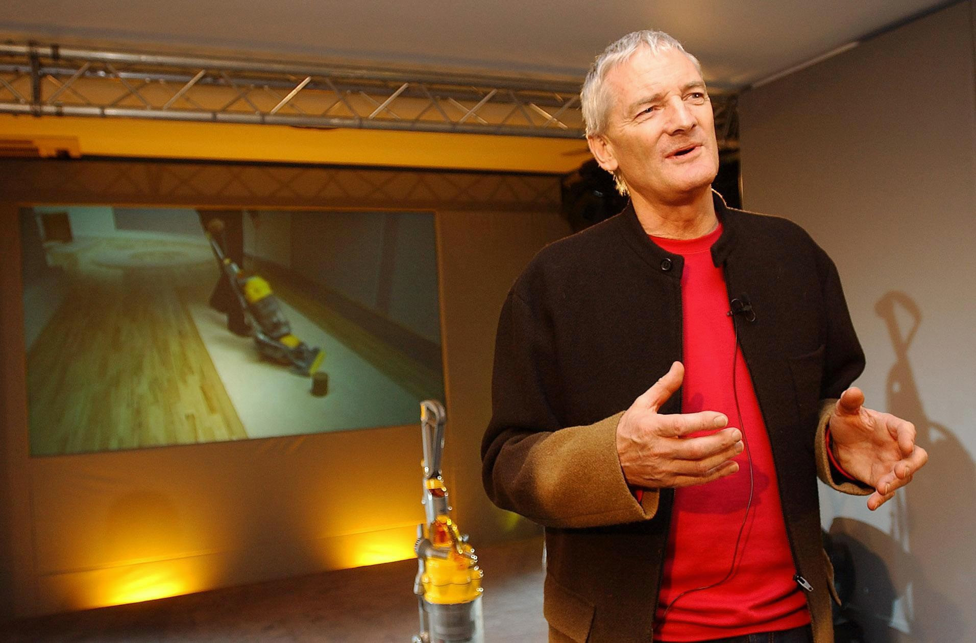 British inventor James Dyson speaks about his new Dyson Ball vacuum cleaner (on screen). The company has invented a machine with a single ball-shaped wheel designed to make it far easier to manoeuvre round furniture and other obstacles.