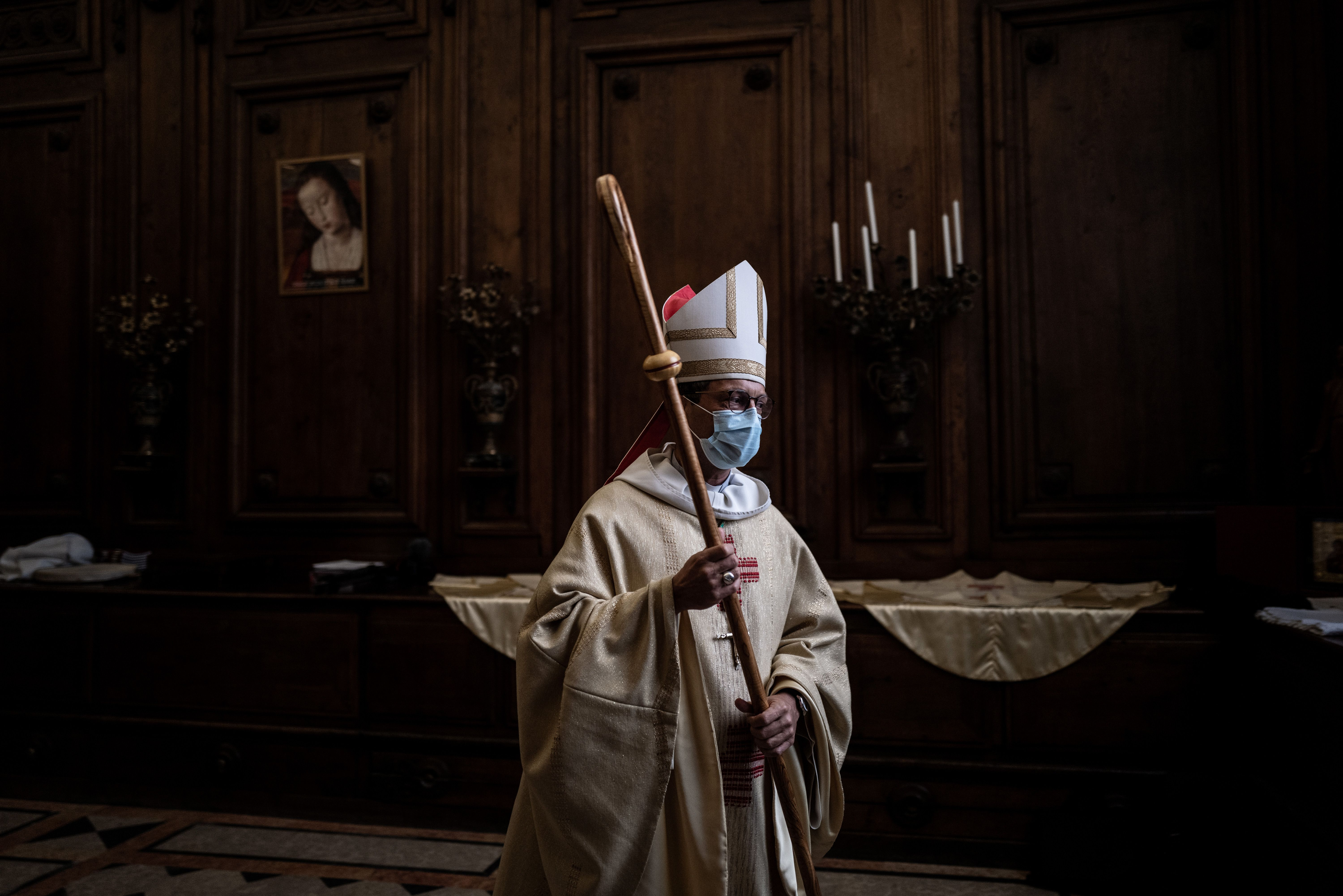 French bishop Monsignor Emmanuel Gobilliard wearing a protective face mask, prepares to lead the first mass in the Lyon Saint-Jean cathedral since the beginning of the lock down due to Covid 19 pandemic, on May 23, 2020. - France went into lockdown on March 17, to curb the spread of COVID-19. (Photo by JEFF PACHOUD / AFP) (Photo by JEFF PACHOUD/AFP via Getty Images)