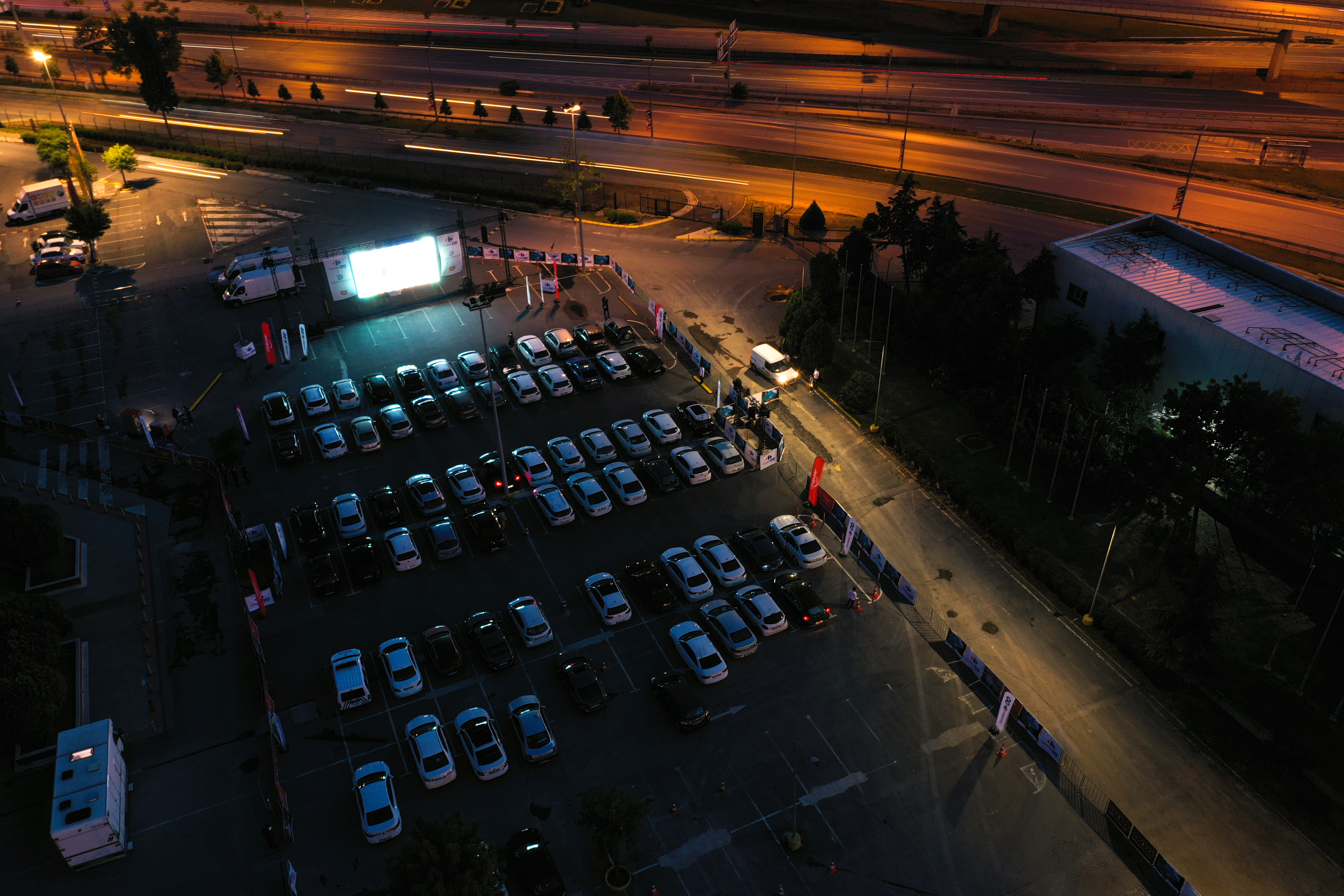 """ISTANBUL, TURKEY - MAY 28: An aerial view of cars during drive-in-theatre amid coronavirus (Covid-19) pandemic organized by CarrefourSA in Istanbul, Turkey on May 28, 2020. The Turkish movie """"Our Family"""" was screened on the theatre. (Photo by Muhammed Enes Yildirim/Anadolu Agency via Getty Images)"""