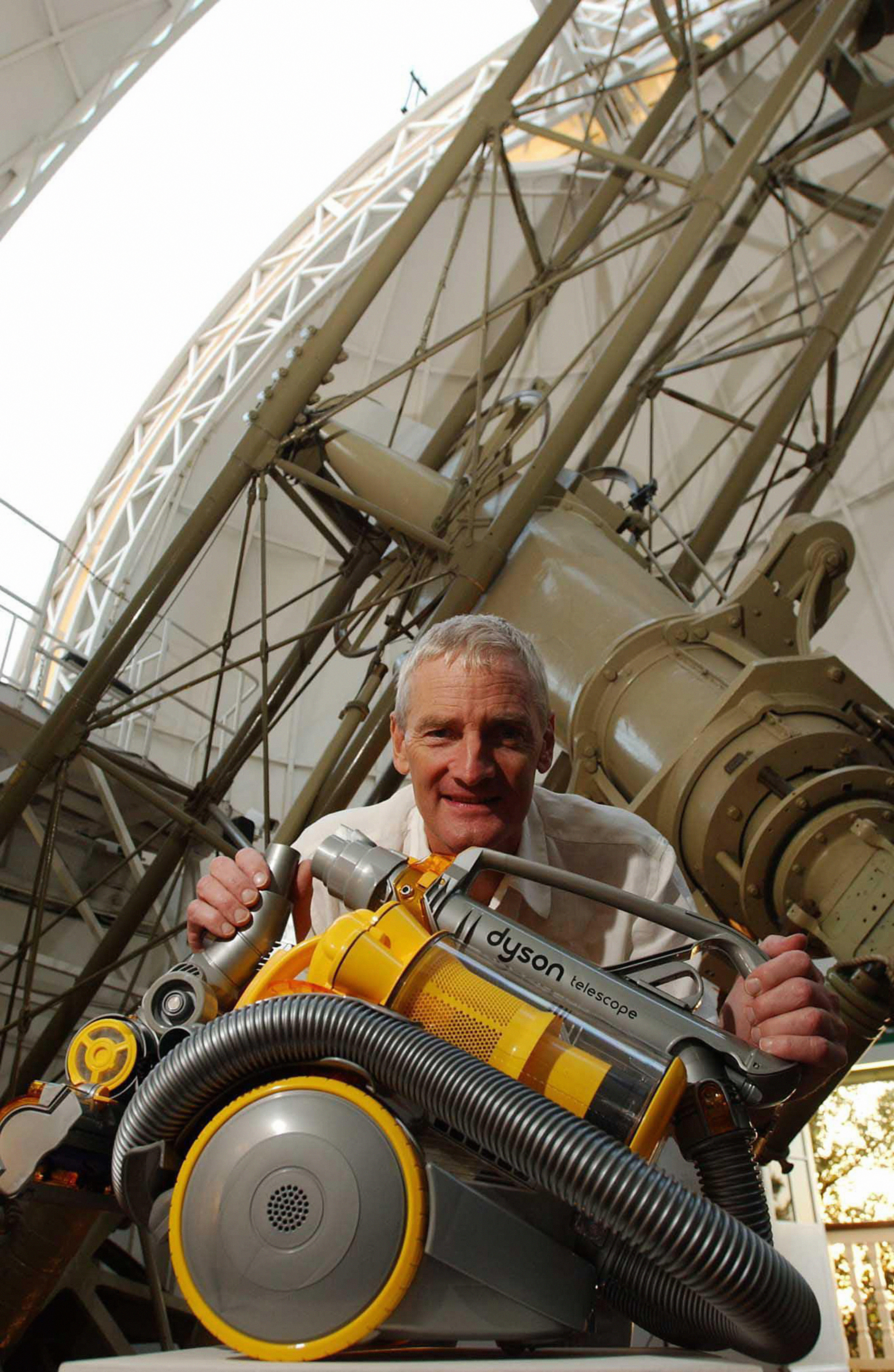James Dyson with the new Telescope Dyson Cleaner, during a photocall for the new product inside the Royal Observatory, Greenwich, London.   *12/11/04: The boss of Dyson and his wife pocketed a  17 million bonus last year after shifting production of the firm's distinctive vacuum cleaners overseas, the company confirmed.