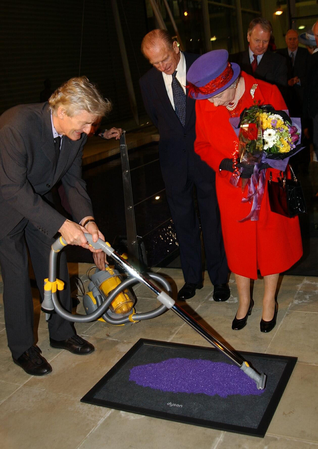 The Queen and the Duke of Edinburgh watch James Dyson unveil a plaque at the vacuum cleaner maker's Malmesbury factory near Chippenham in Wiltshire, during a visit to the town. She travelled by scheduled train with the Duke of Edinburgh for a day of engagements.  * around the area.