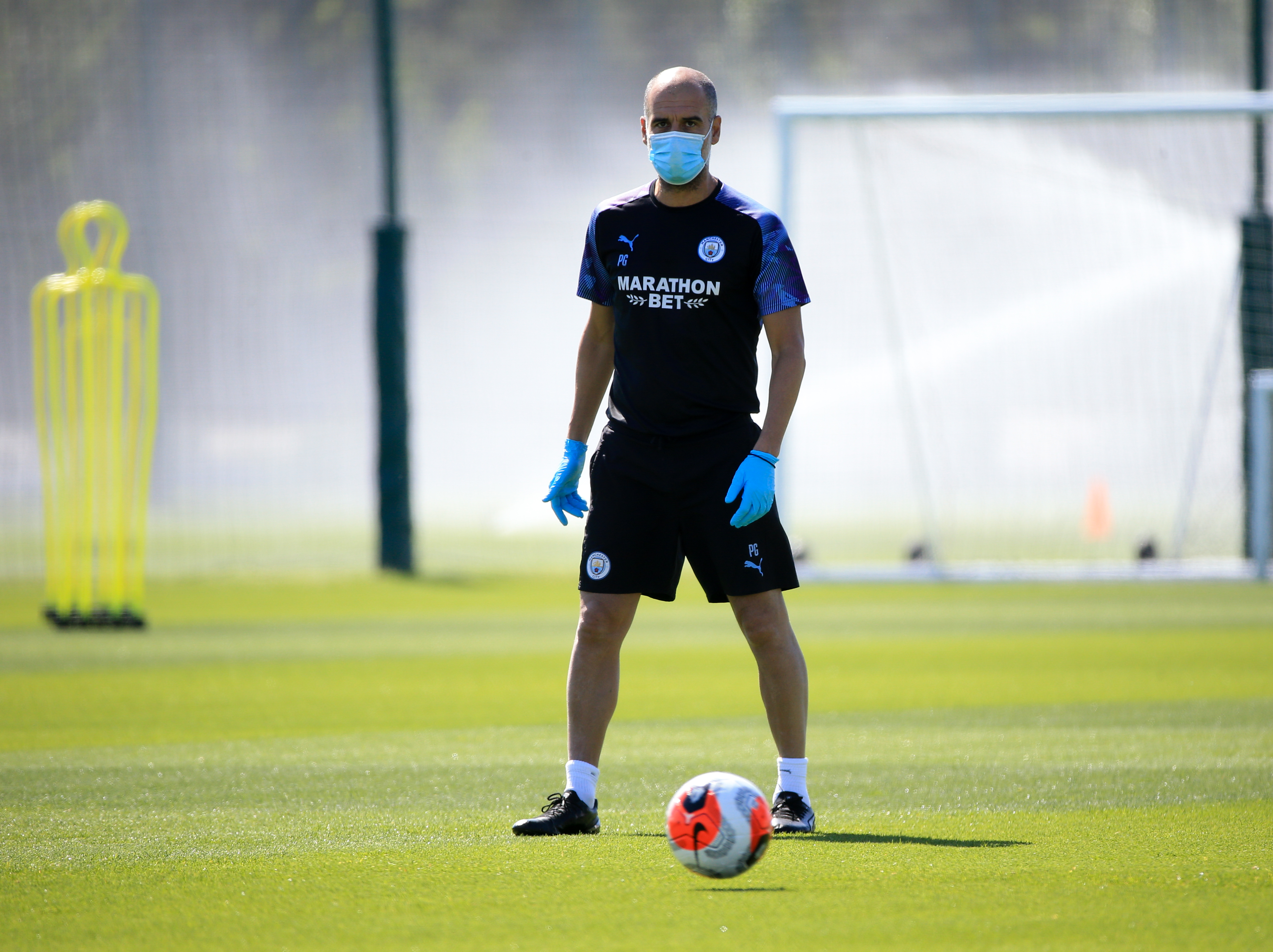 MANCHESTER, ENGLAND - MAY 25: Manchester City's Pep Guardiola in action during training at Manchester City Football Academy on May 25, 2020 in Manchester, England. (Photo by Tom Flathers/Manchester City FC via Getty Images)