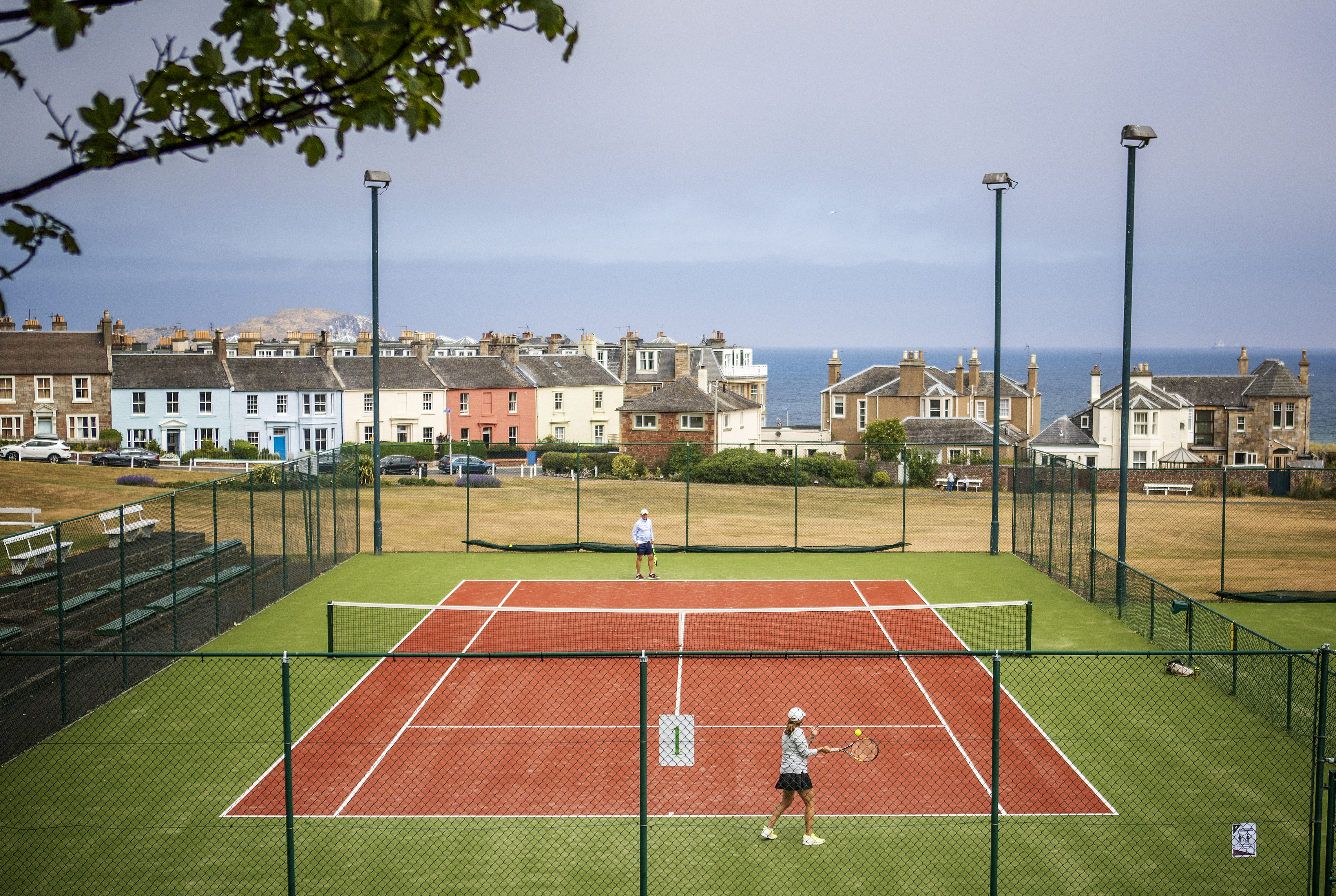 People play tennis at North Berwick Tennis Club, as people can meet family and friends outdoors and play sports such as golf and tennis again as Scotland is moving into phase one of the Scottish Government's plan for gradually lifting lockdown.
