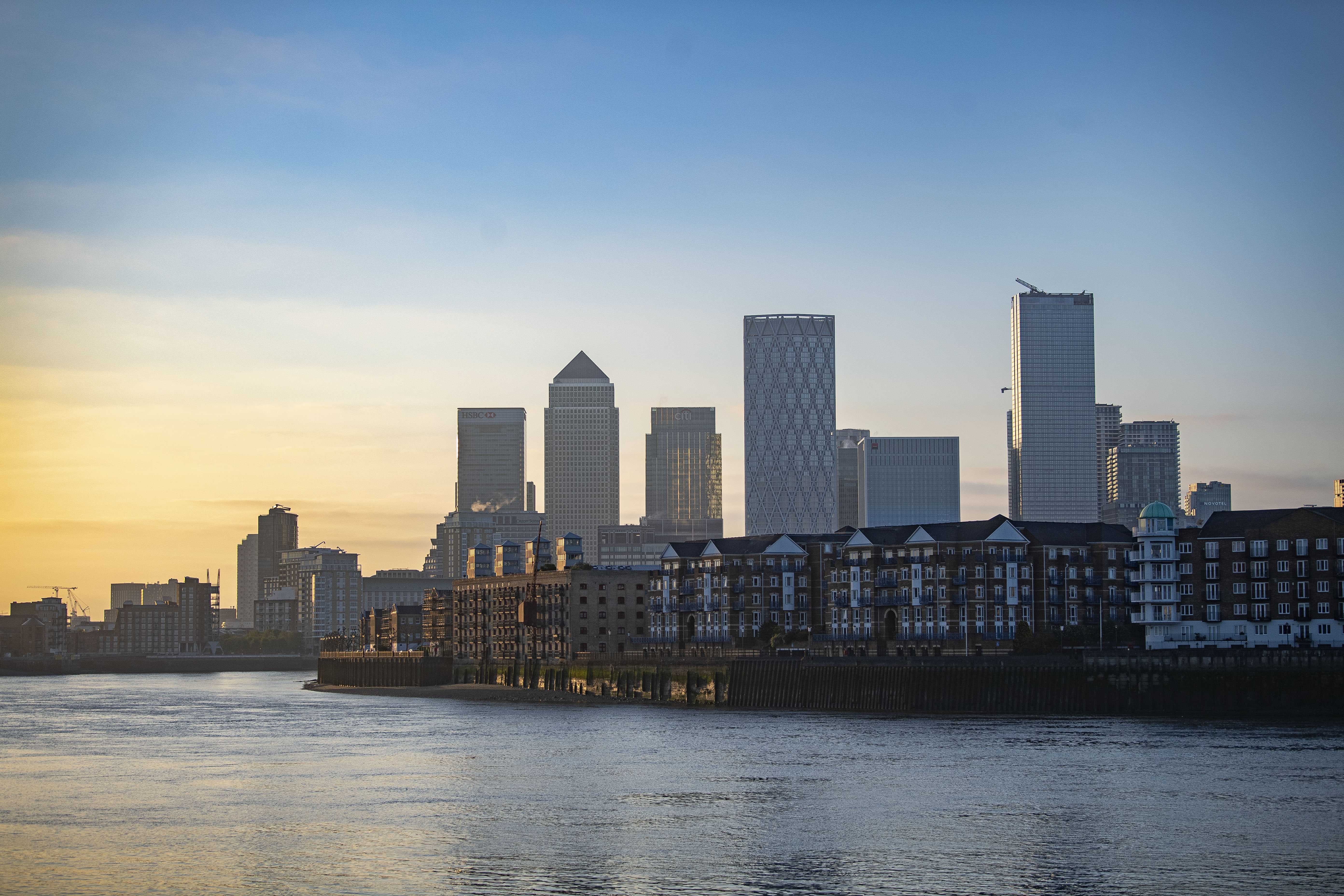 The sun rises over Canary Wharf in east London as the UK continues in lockdown to help curb the spread of the coronavirus.