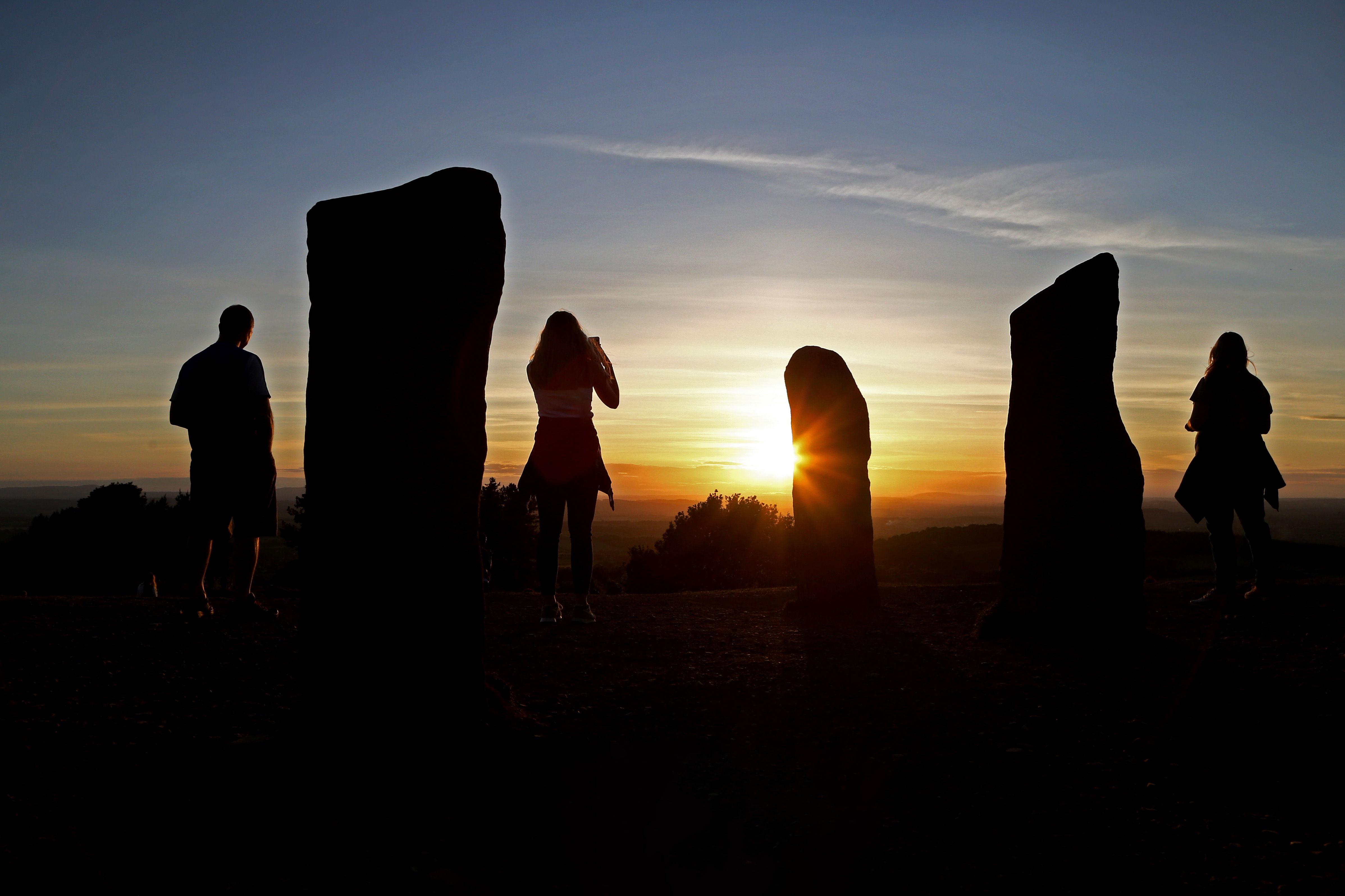 STOURBRIDGE, ENGLAND - MAY 25: A family watch the sunset at Clent Hills on May 25, 2020 near Stourbridge, Worcestershire, England. The British government has started easing the lockdown it imposed two months ago to curb the spread of Covid-19, abandoning its 'stay at home' slogan in favour of a message to 'be alert', but UK countries have varied in their approaches to relaxing quarantine measures. (Photo by Cameron Smith/Getty Images)