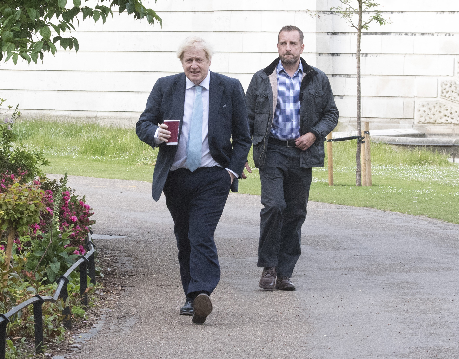 Prime Minister Boris Johnson takes a morning walk in St James' Park in London before returning to Downing Street, as the UK enters a seventh week of lockdown to help stop the spread of coronavirus.