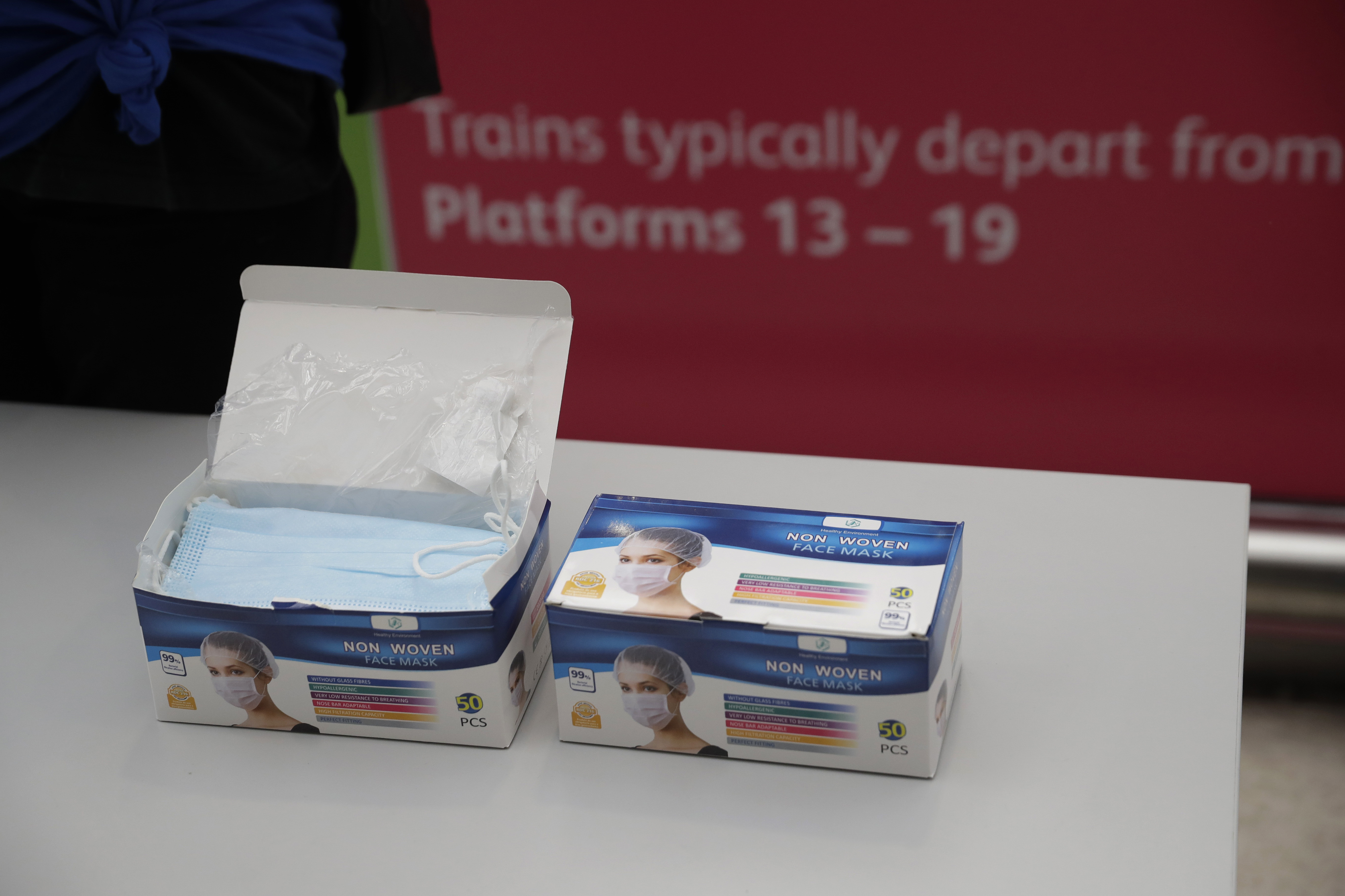 Face masks stand ready to be given out to people to help stop the spread of coronavirus in Waterloo station, London, Thursday, June 4, 2020. Waterloo station, which is wide recognised as the busiest train station in Britain, is still much quieter than normal as most commuters are working from home and not commuting into central London offices. (AP Photo/Matt Dunham)