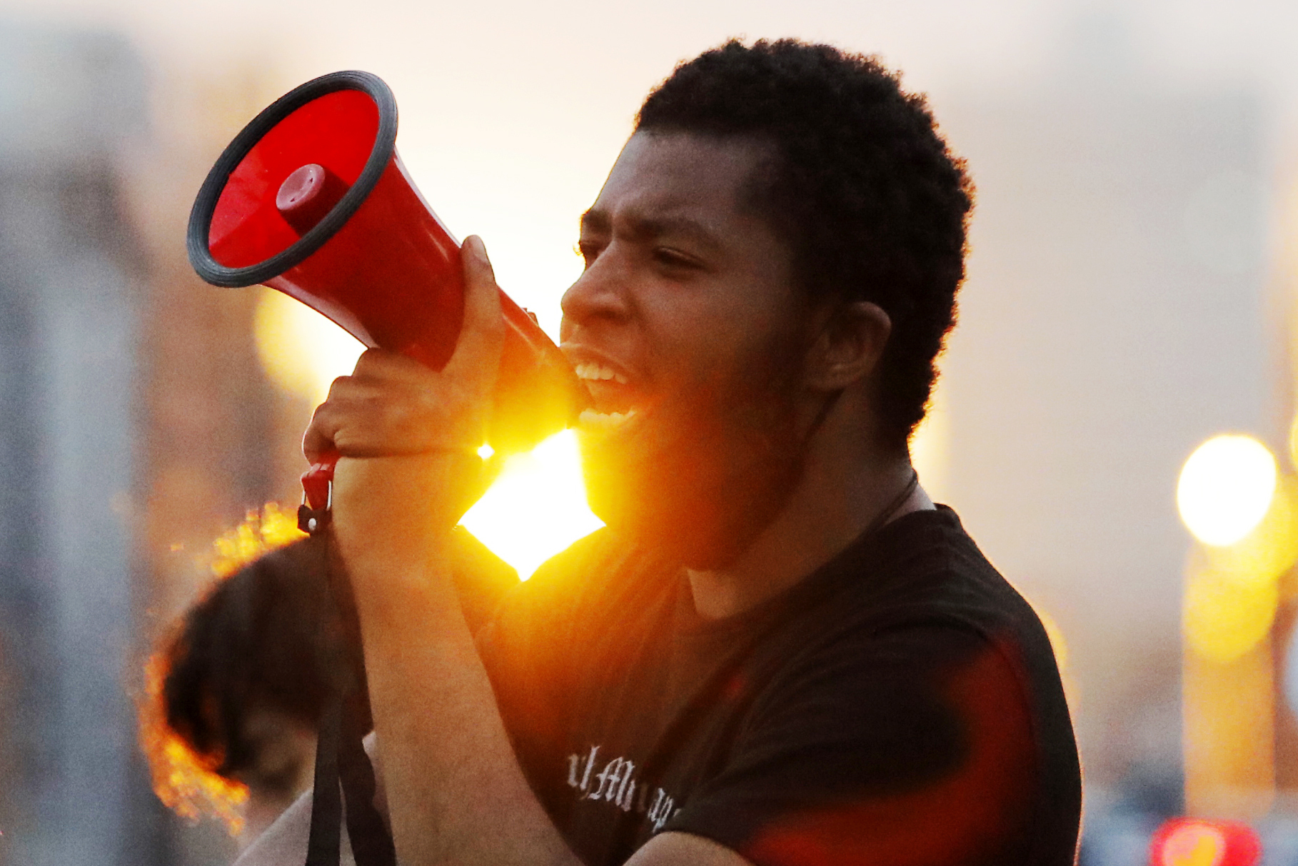 A protest leader chants with demonstrators Sunday, May 31, 2020, after curfew in Minneapolis. Protests continued following the death of George Floyd, who died after being restrained by Minneapolis police officers on Memorial Day. (AP Photo/Julio Cortez)