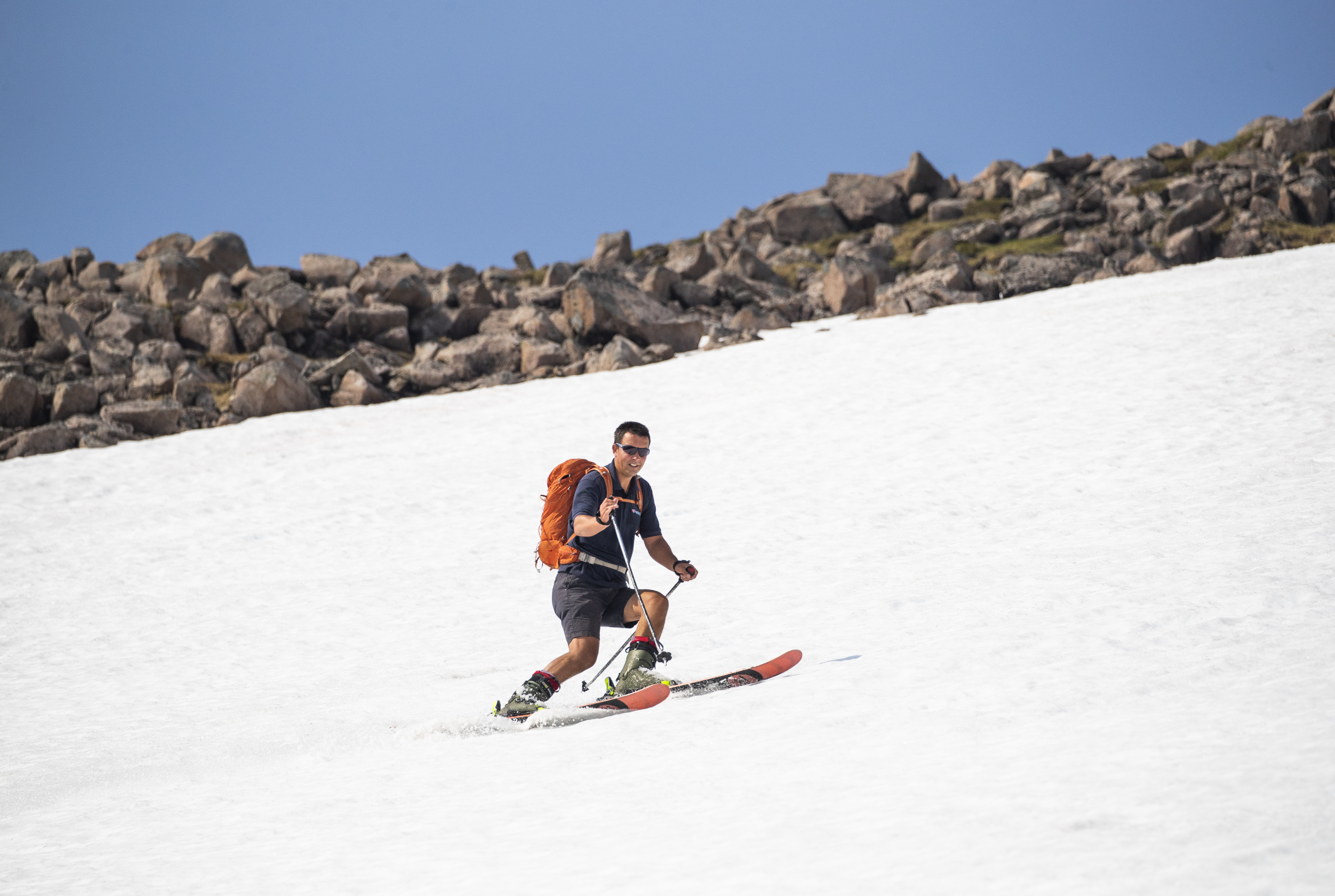 Andy Meldrum, owner of the Glencoe Mountain Resort, skis on some of the remaining snow patches on the slopes of Meall a'Bhuiridh in Glencoe as Thursday could be the UK's hottest day of the year with scorching temperatures forecast to rise even further.