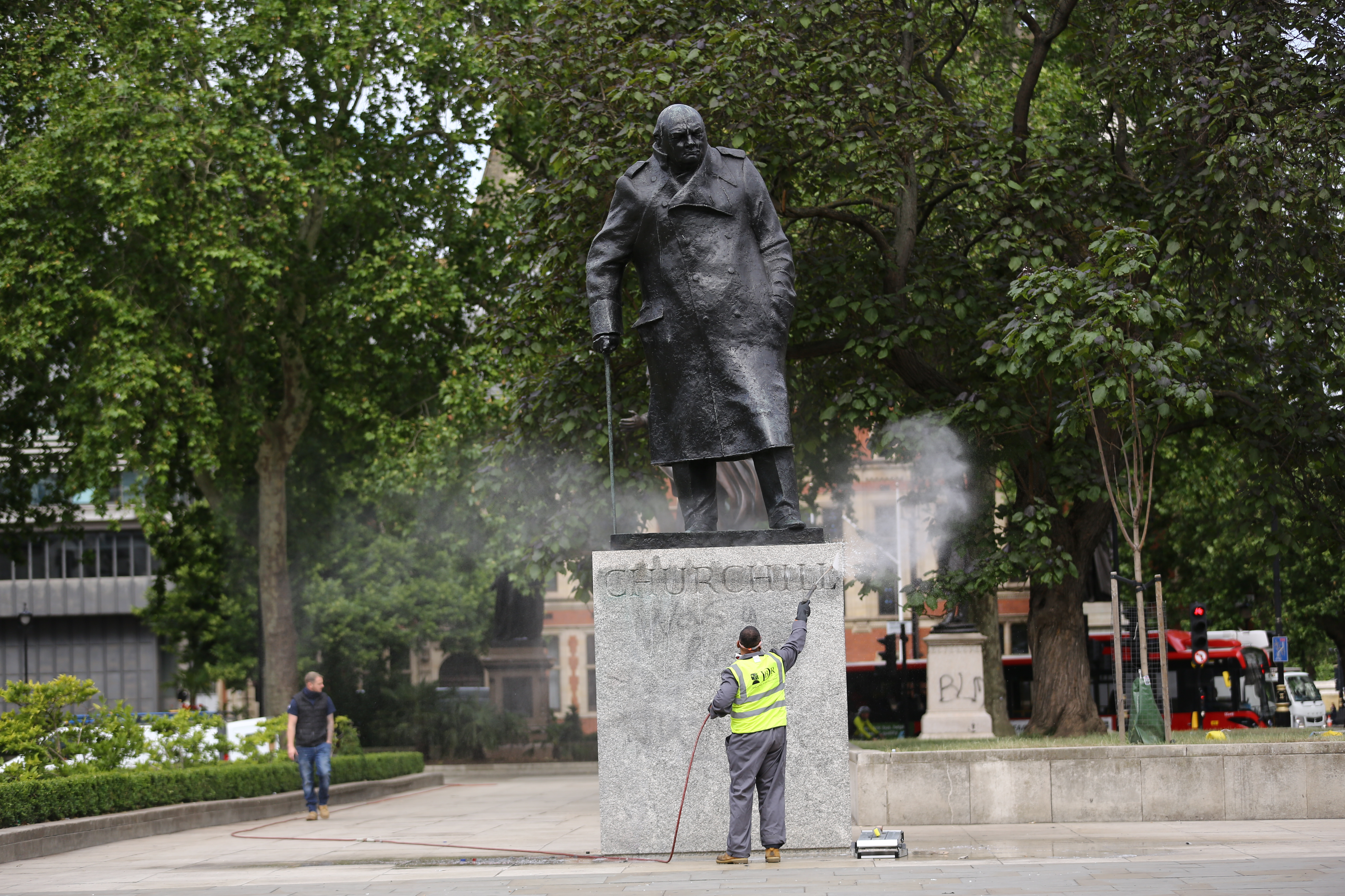 A worker cleans graffiti from the plinth of the statue of Sir Winston Churchill at Parliament Square in London, following a Black Lives Matter protest at the weekend. A raft of protests across the UK were sparked by the death of George Floyd, who was killed on May 25 while in police custody in the US city of Minneapolis.