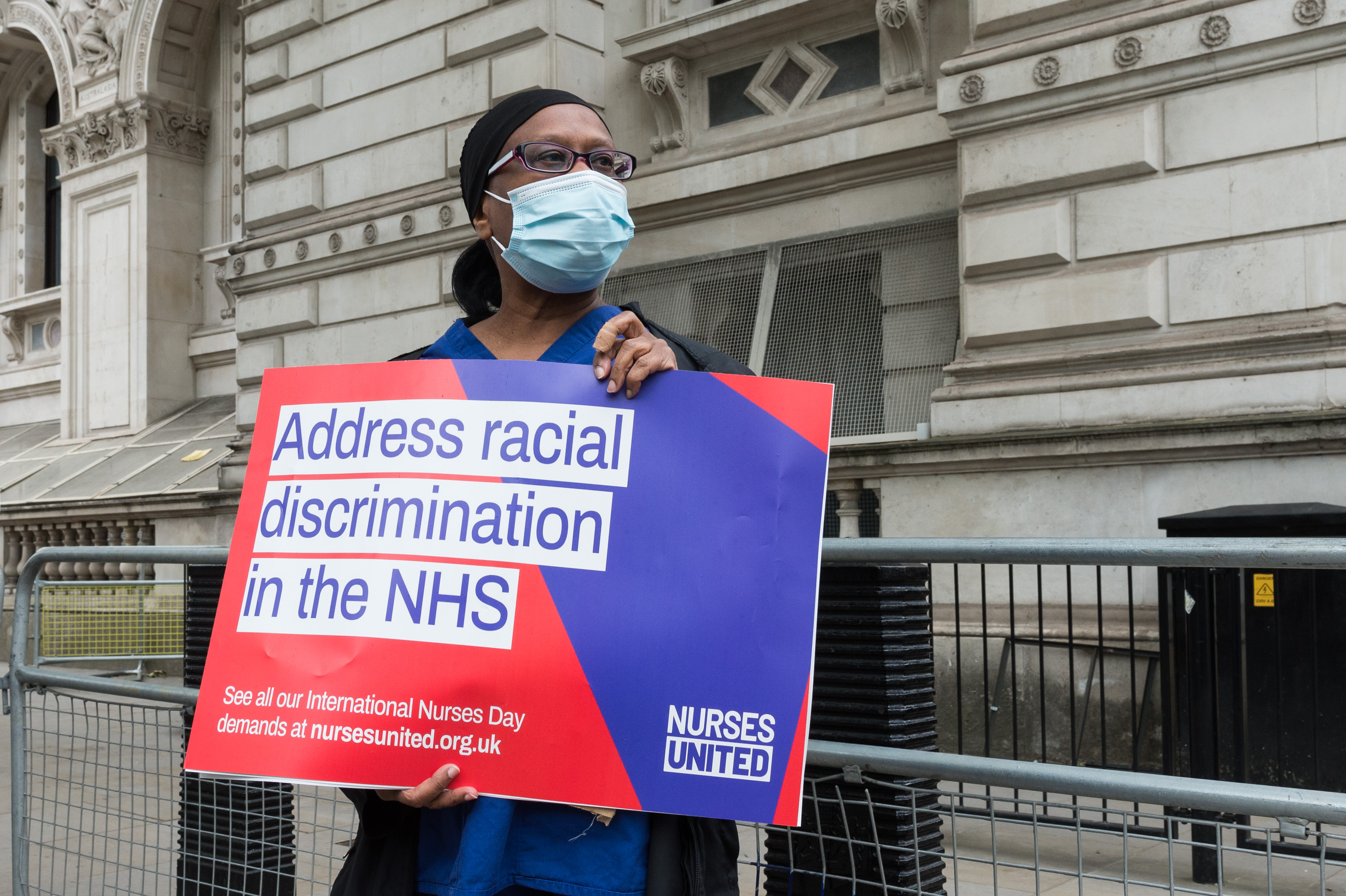 A group of nurses wearing face masks protest outside Downing Street demanding a pay rise, effective protection against COVID-19 and highlighting a disproportionately higher mortality rate from the novel coronavirus among BAME ethnic minority groups on 03 June, 2020 in London, England. (Photo by WIktor Szymanowicz/NurPhoto via Getty Images)