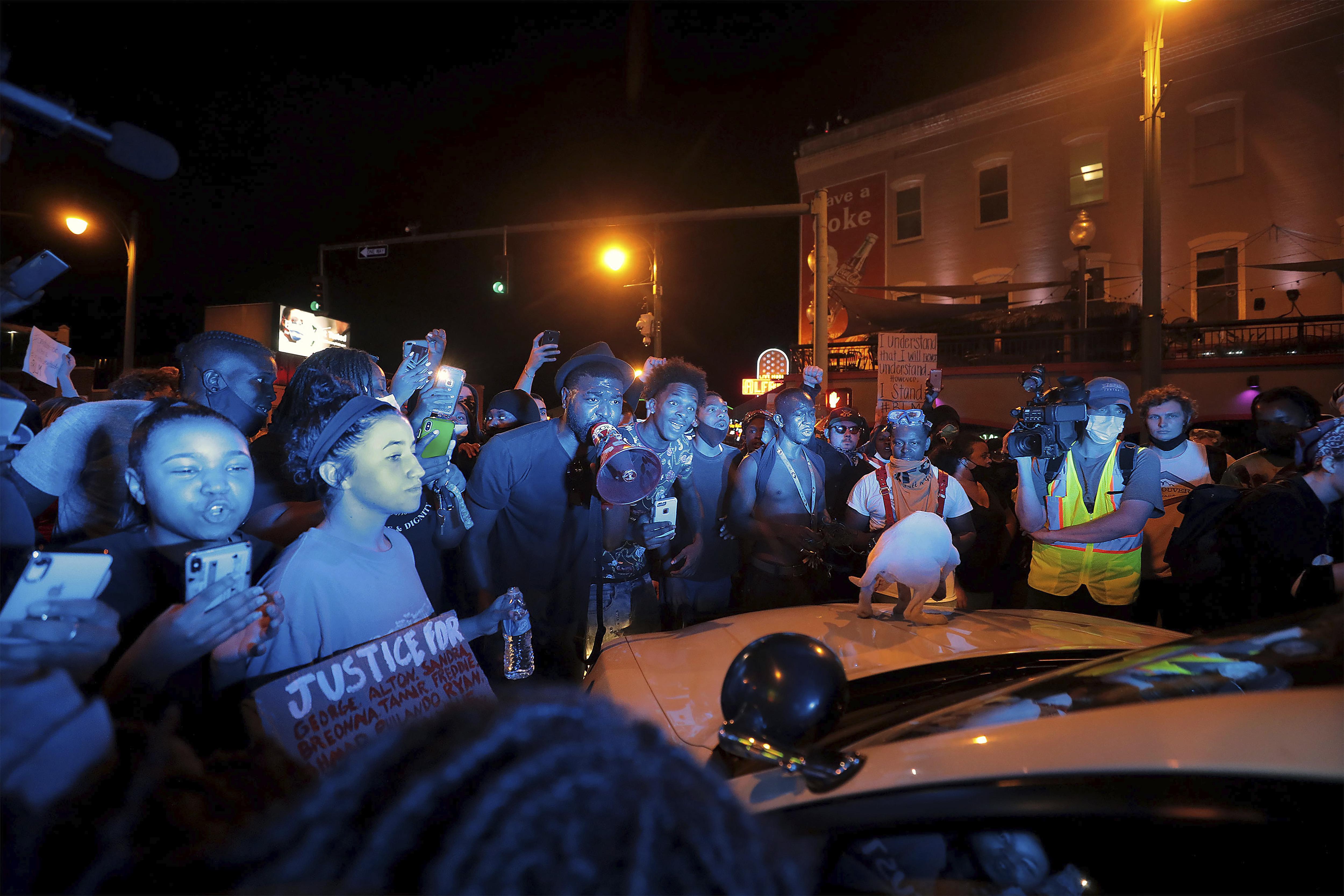 Protestors confront a police officer in his car in Memphis, Tennessee during a protest over the death of George Floyd May 31, 2020. (Patrick Lantrip/Daily Memphian via AP)