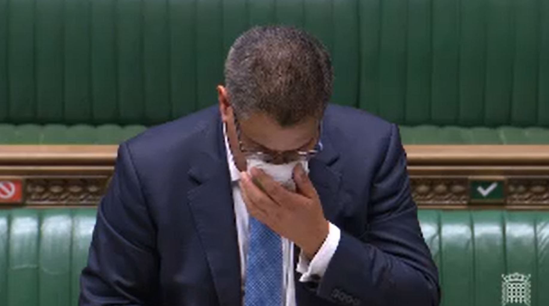 Business Secretary Alok Sharma wipes his face during a speech in the House of Commons, London. Sharma has been tested for coronavirus after becoming visibly unwell in the debating chamber. (Photo by House of Commons/PA Images via Getty Images)