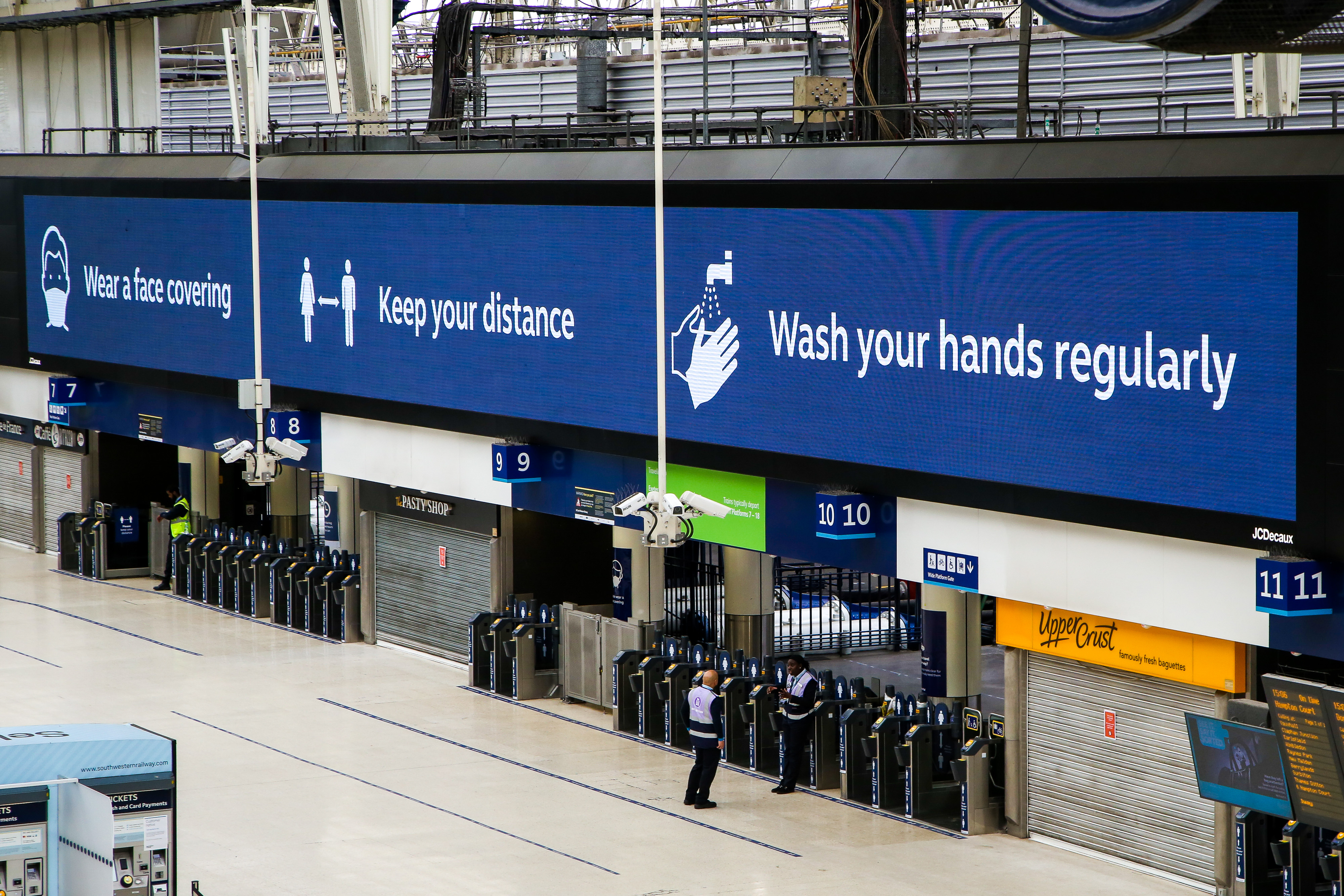 LONDON, UNITED KINGDOM - 2020/06/05: Wear a face covering. Keep your distance. Wash your hands regularly is displayed on a Coronavirus public information campaign poster at London Waterloo Station. (Photo by Dinendra Haria/SOPA Images/LightRocket via Getty Images)
