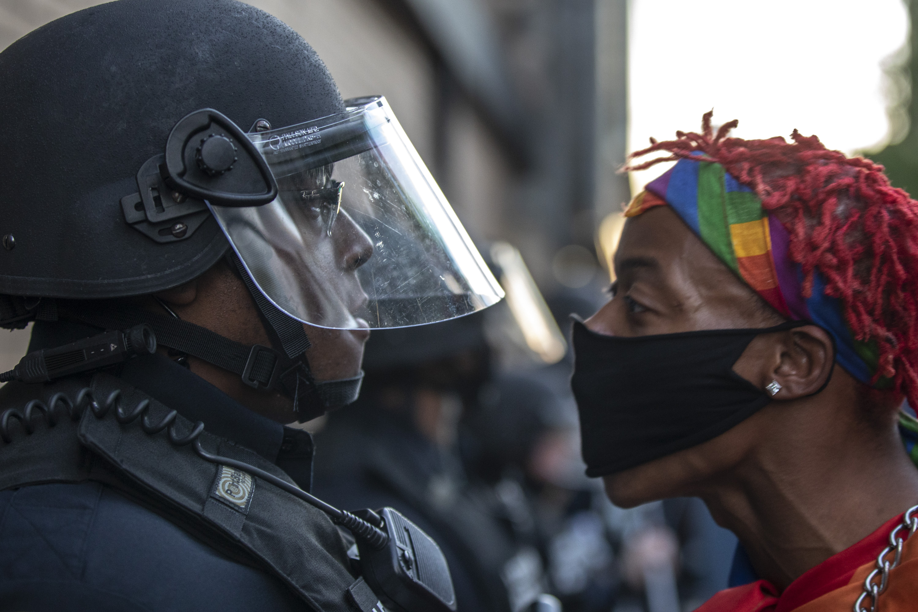 A protester confronts police during a rally in downtown Lexington, Ky., against the deaths of George Floyd and Breonna Taylor on Sunday, May 31, 2020. (Ryan C. Hermens/Lexington Herald-Leader via AP)