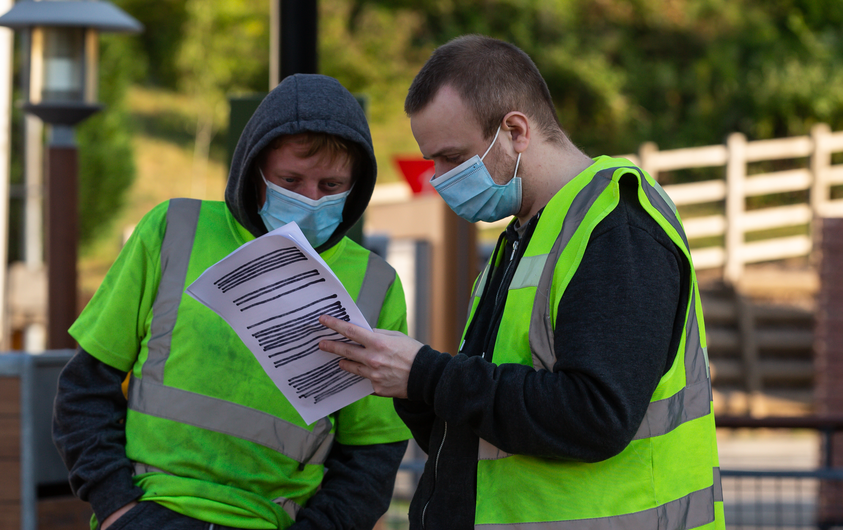 BLACKWOOD, WALES - JUNE 2: Staff wearing PPE check over a delivery list at Mcdonlad's as they prepare to resume trading for takeaway only in Wales within the next 24 hours following lockdown on June 2, 2020 in Blackwood, Wales, United Kingdom. The British government continues to ease the coronavirus lockdown by announcing schools will open to reception year pupils plus years one and six from June 1st. Open-air markets and car showrooms can also open from the same date. (Photo by Huw Fairclough/Getty Images)