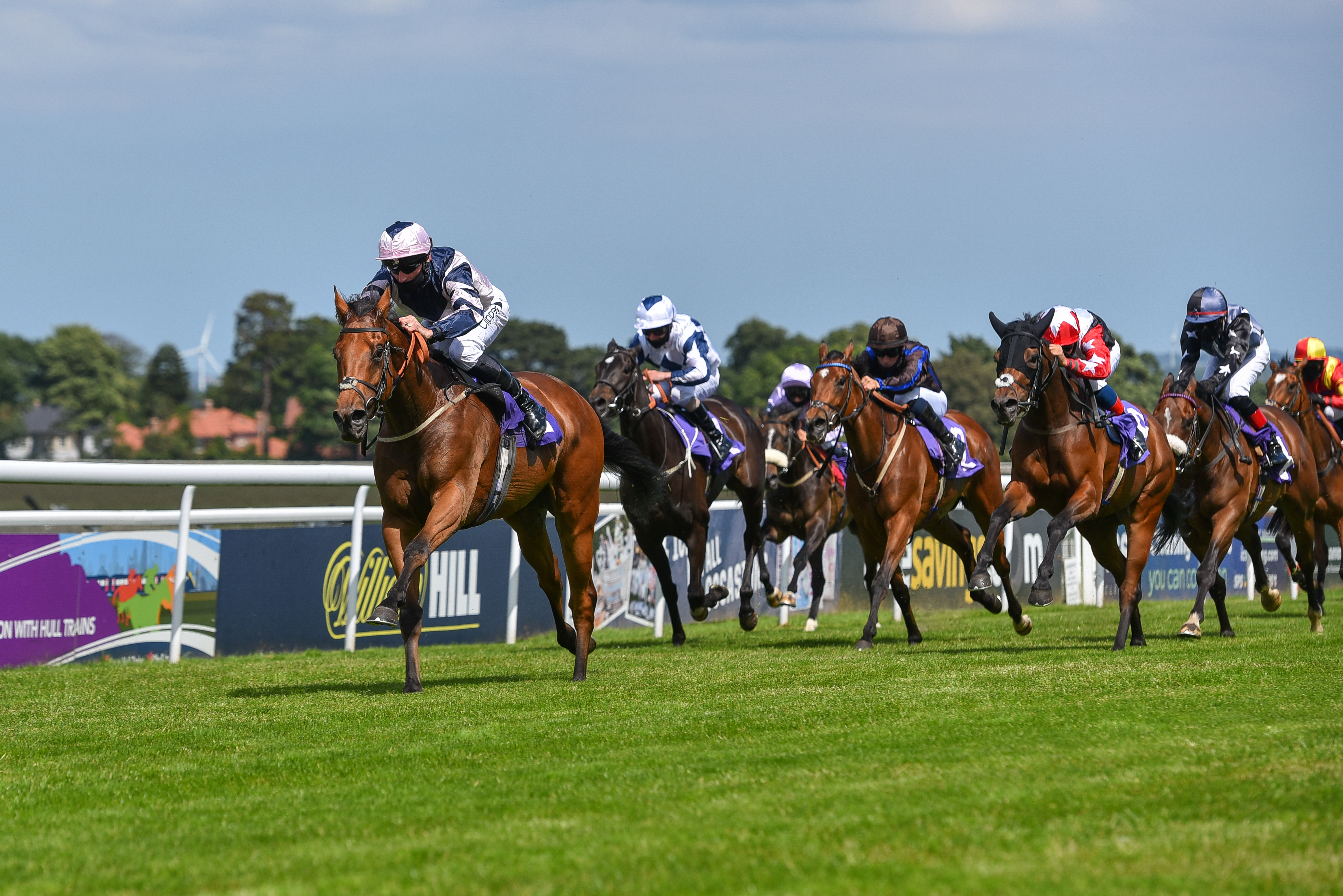 BEVERLEY, ENGLAND - JUNE 23: Jockey Danny Tudhope riding Le Chiffre approach the finish line to win the William Hill Lengthen #yourodds Handicap (Div I) at Beverley Racecourse on June 23, 2020 in Beverley, England. (Photo by Hannah Ali/Pool via Getty Images)