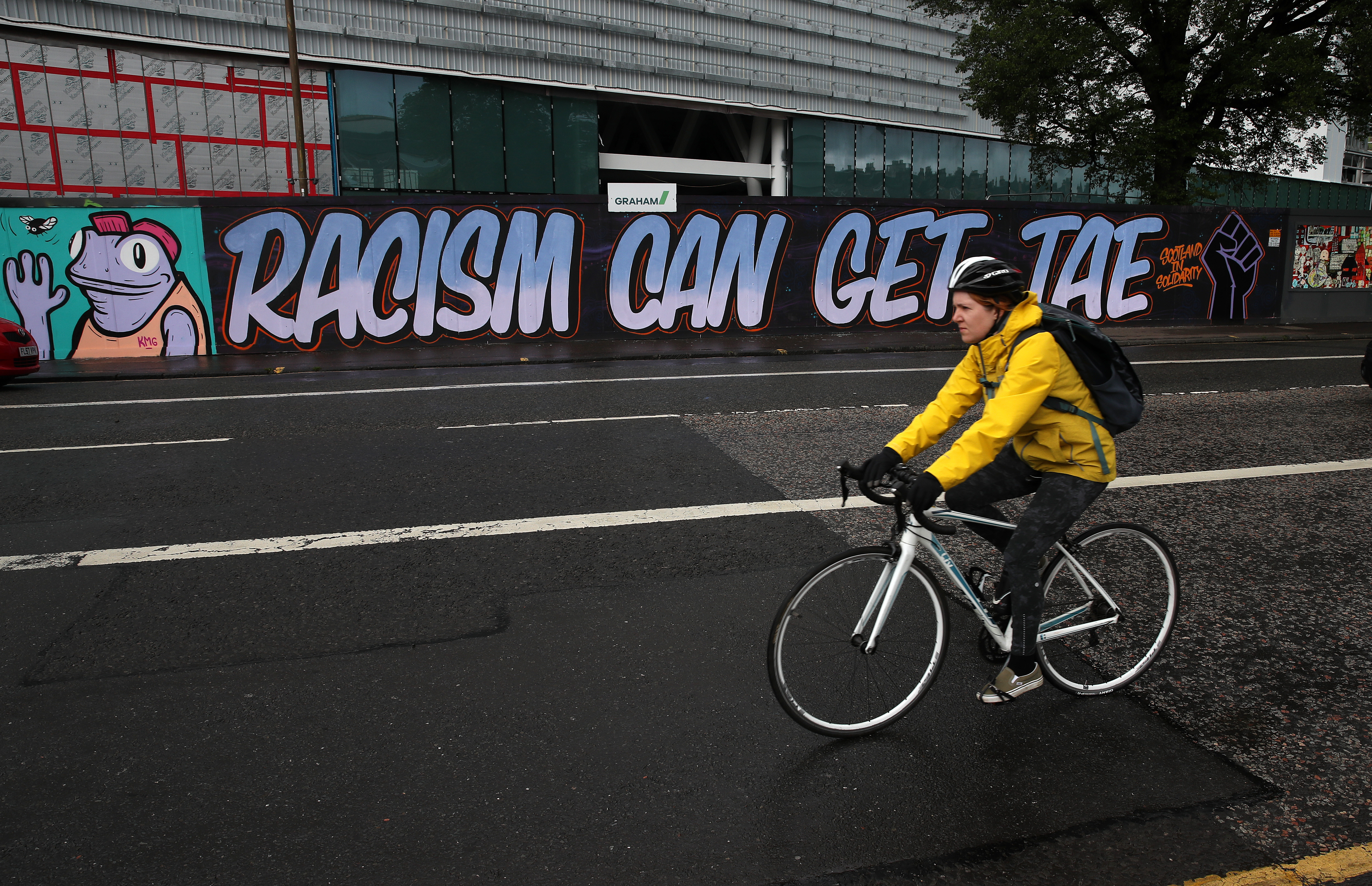 A cyclist passes graffiti in Edinburgh following a raft of Black Lives Matter protests took place across the UK over the weekend. The protests were sparked by the death of George Floyd, who was killed on May 25 while in police custody in the US city of Minneapolis.