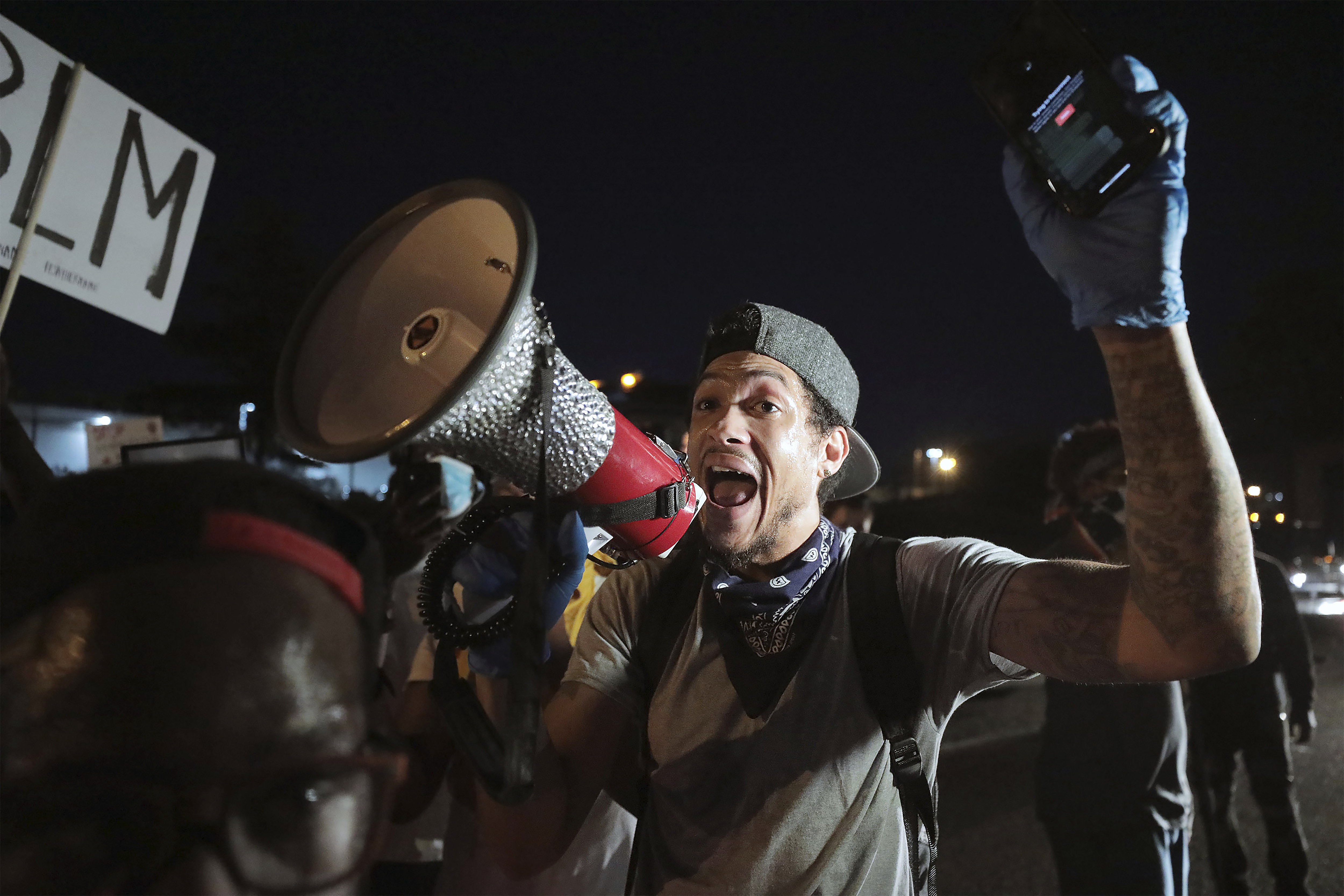 Protestors celebrate after eluding authorities and stopping traffic along Interstate 55 in Memphis, Tennessee, Sunday, May 31, 2020, during a protest over the death of George Floyd on May 25. (Patrick Lantrip/Daily Memphian via AP)