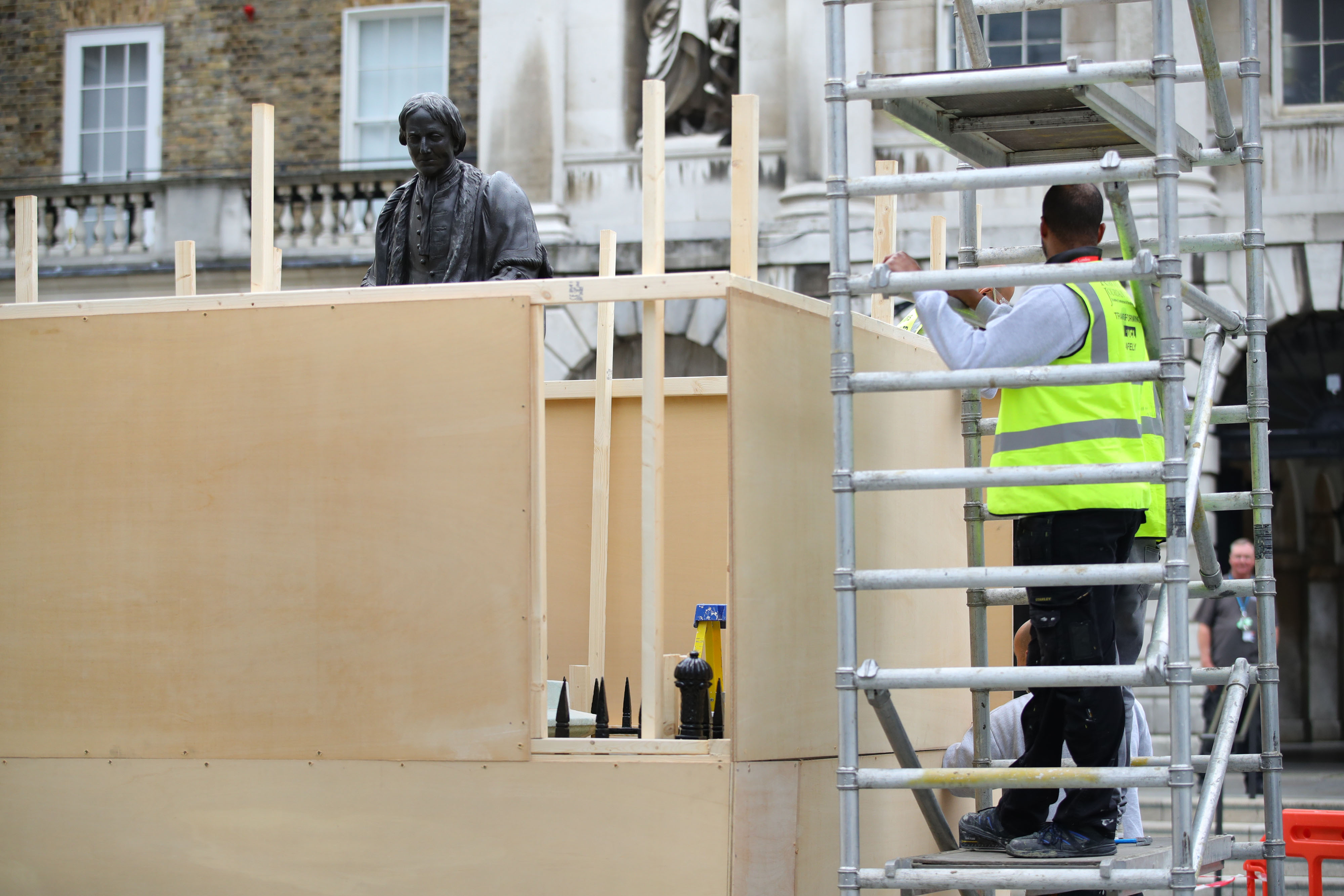 Boards being put up around the statue of Thomas Guy at Guy's hospital in London, following a raft of Black Lives Matter protests that took place across the UK over the weekend. The protests were sparked by the death of George Floyd, who was killed on May 25 while in police custody in the US city of Minneapolis.