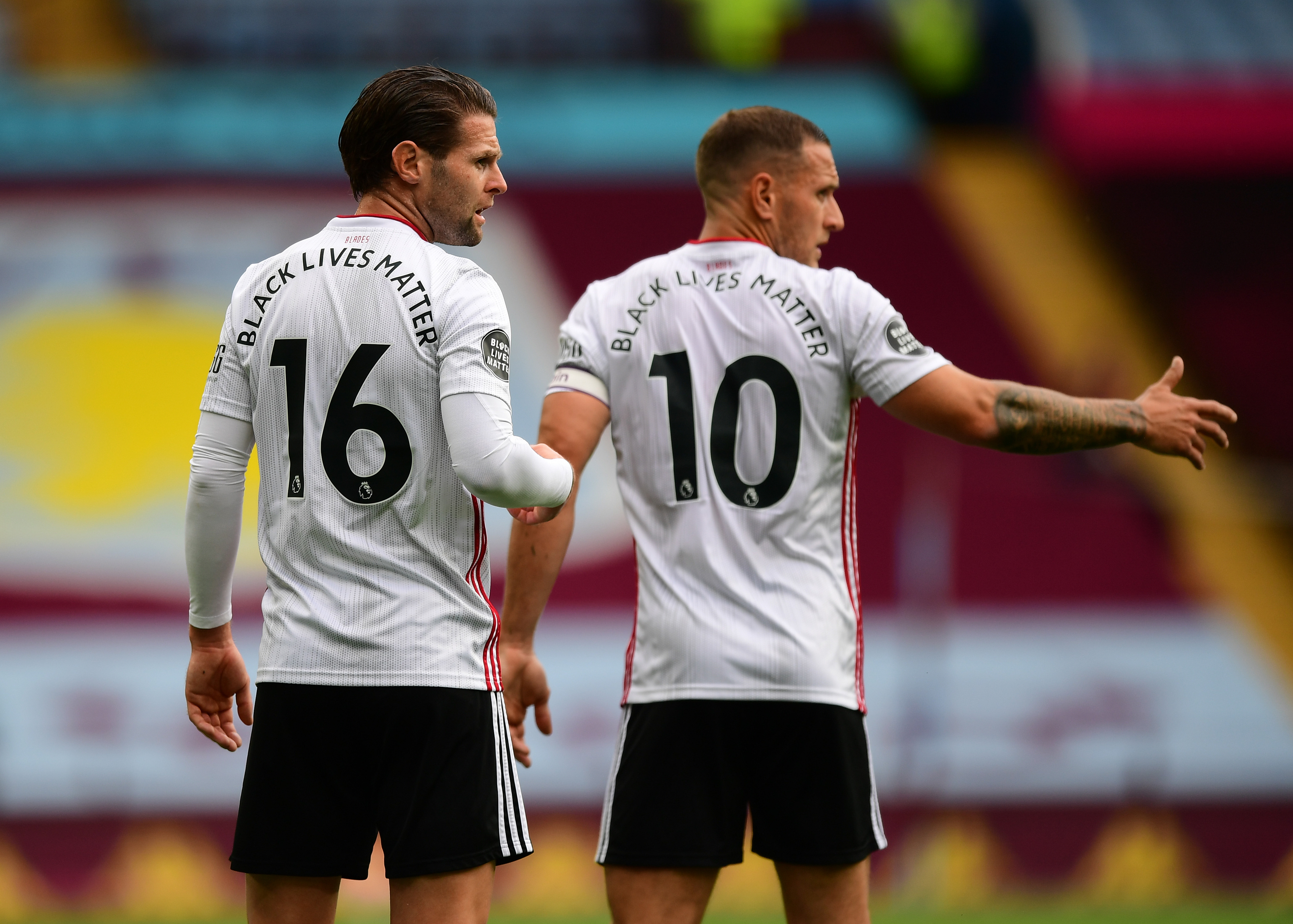 BIRMINGHAM, ENGLAND - JUNE 17:  Black Lives Matter writing is seen on the back of Ollie Norwood and Billy Sharp of Sheffield United shirts during the Premier League match between Aston Villa and Sheffield United at Villa Park on June 17, 2020 in Birmingham, England. (Photo by Shaun Botterill/Getty Images)