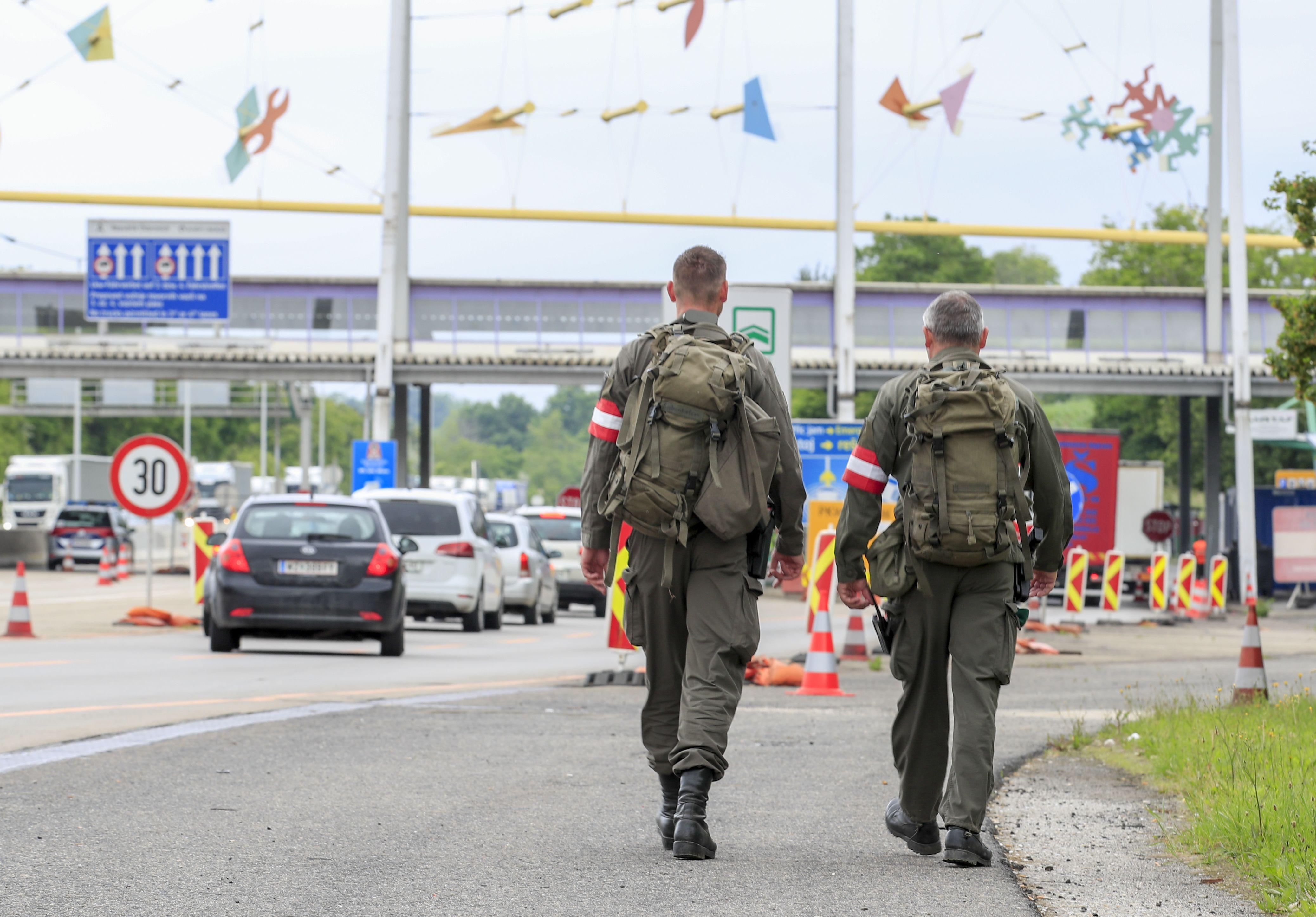 Austrian soldiers patrol at the Austrian-Slovenian border at the checkpoint near Spielfeld, Austria, on June 5, 2020. - Austria scrapped entry checks at its land borders introduced because of the coronavirus pandemic, except those at the frontier with Italy. Slovenia reciprocated the reopening from Friday, June 5, 2020 and lets in people travelling from Austria without checks. (Photo by ERWIN SCHERIAU / APA / AFP) / Austria OUT (Photo by ERWIN SCHERIAU/APA/AFP via Getty Images)